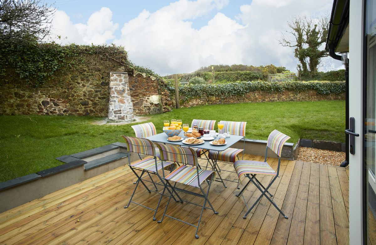 Sun deck with garden table and chairs