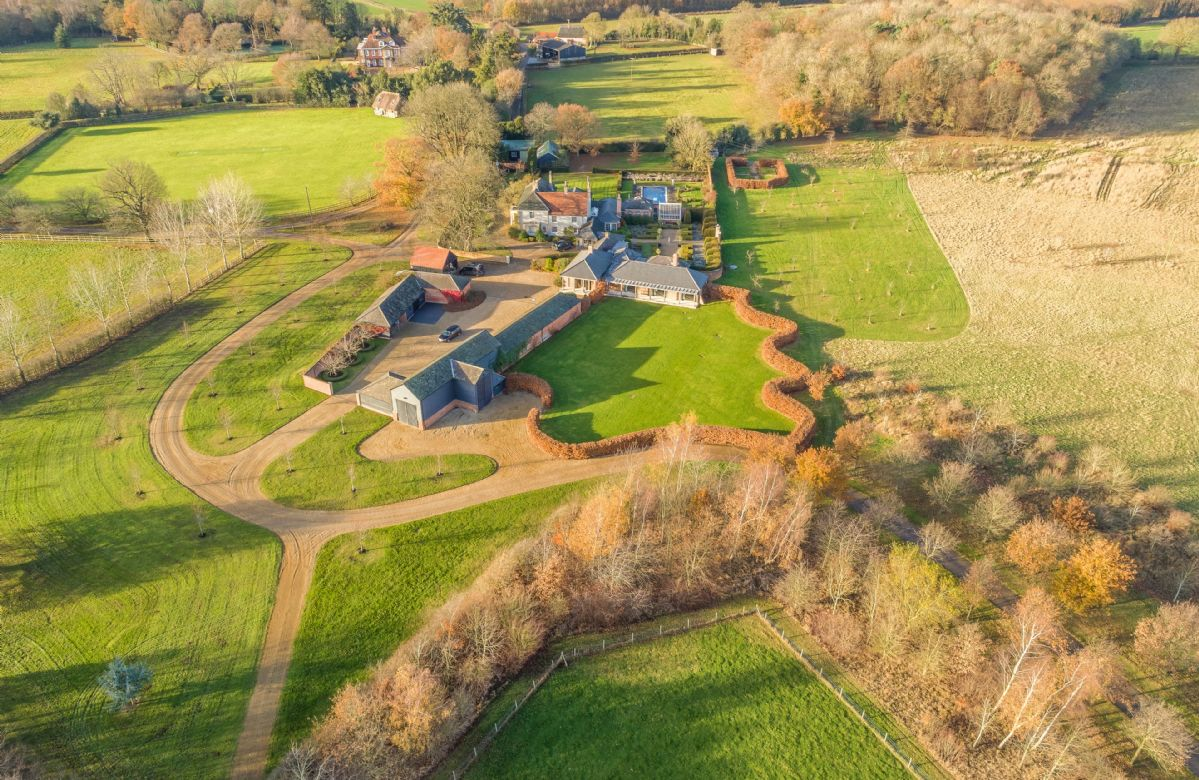 Part of a private estate in an Area of Outstanding Natural Beauty, the property is surrounded by acres of rolling Constable Countryside