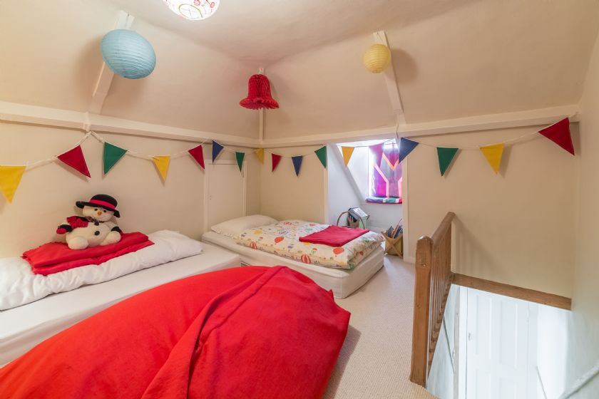 Attic:  Bedroom with three mattresses suitable for children aged 7 years and under