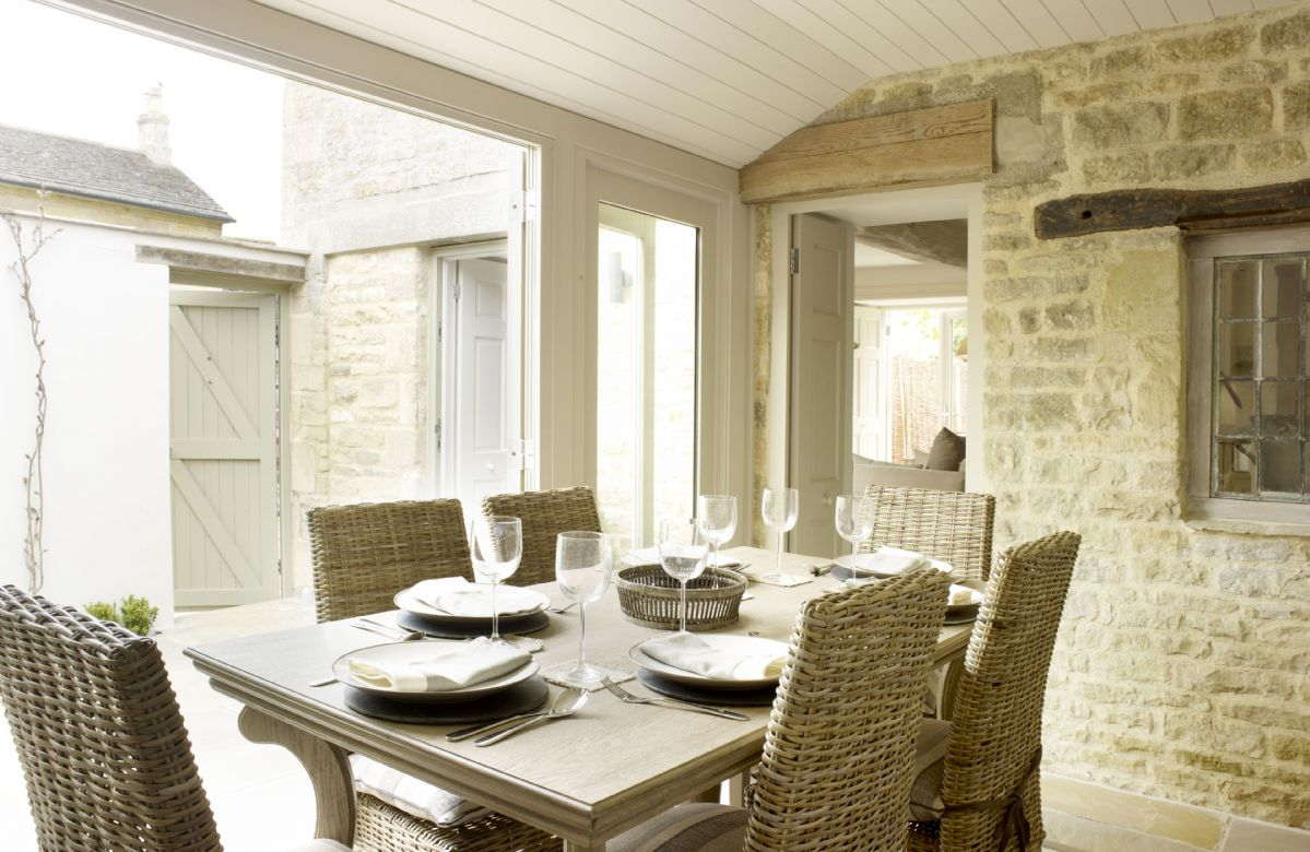 Ground floor: Dining room with French doors opening on the the courtyard garden