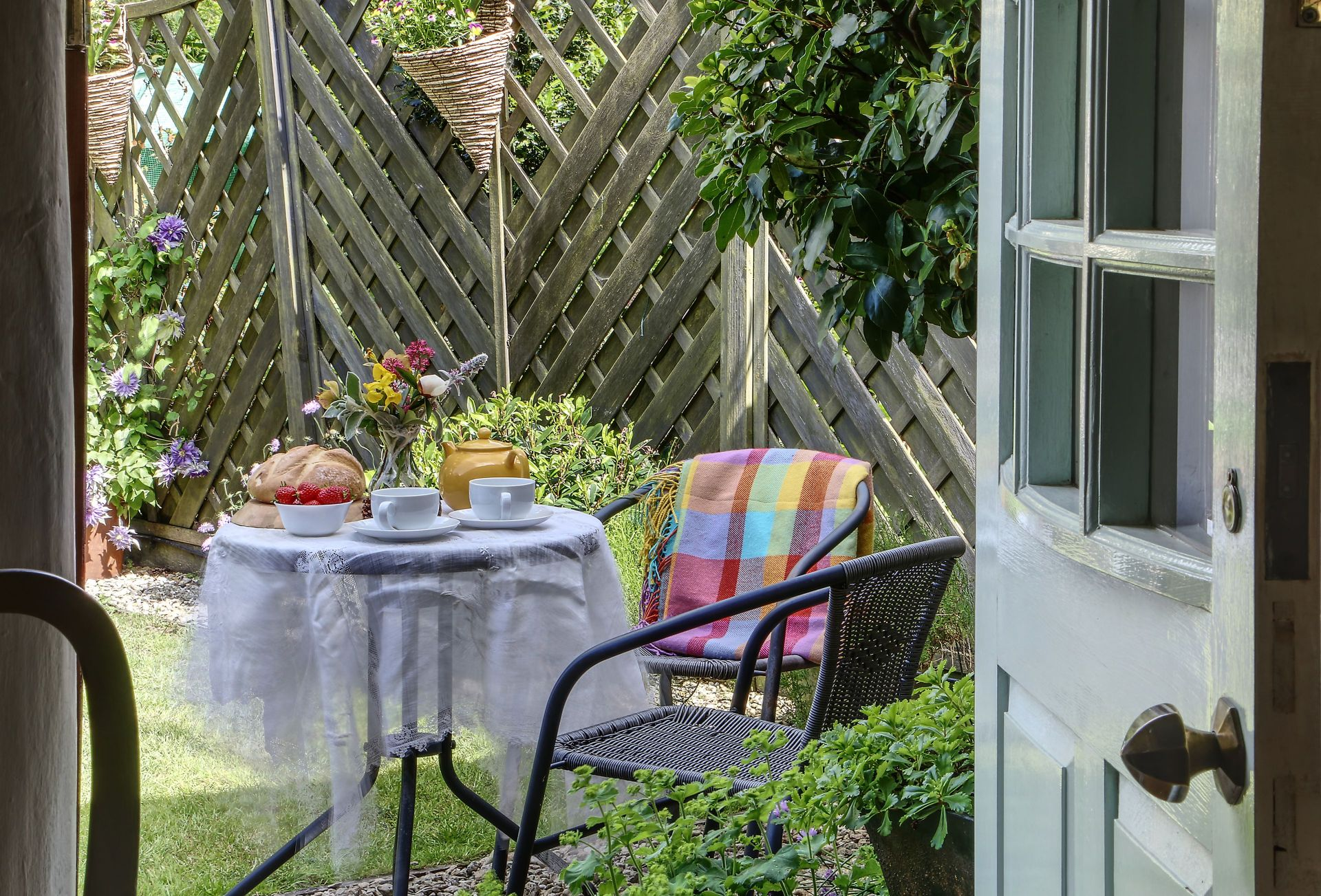 To the front of the cottage you'll find a country cottage garden and garden furniture