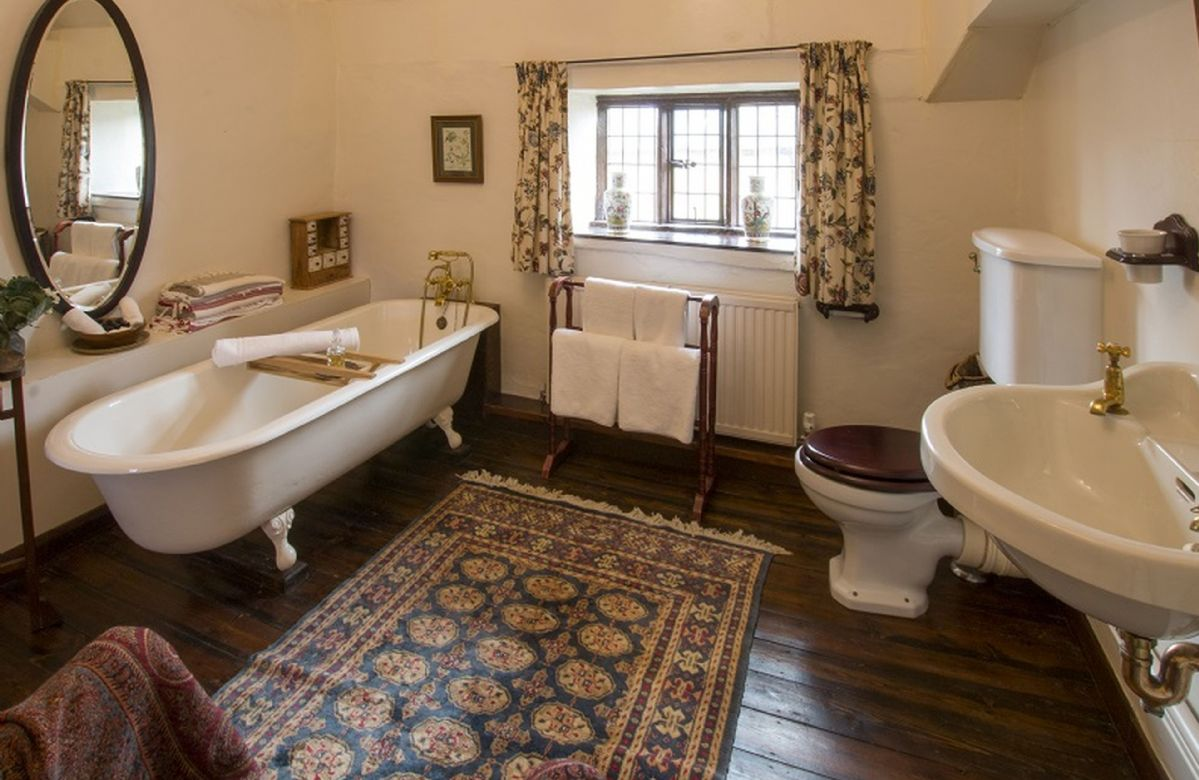 First floor: Bathroom with cast iron claw foot bath and handheld shower attachment
