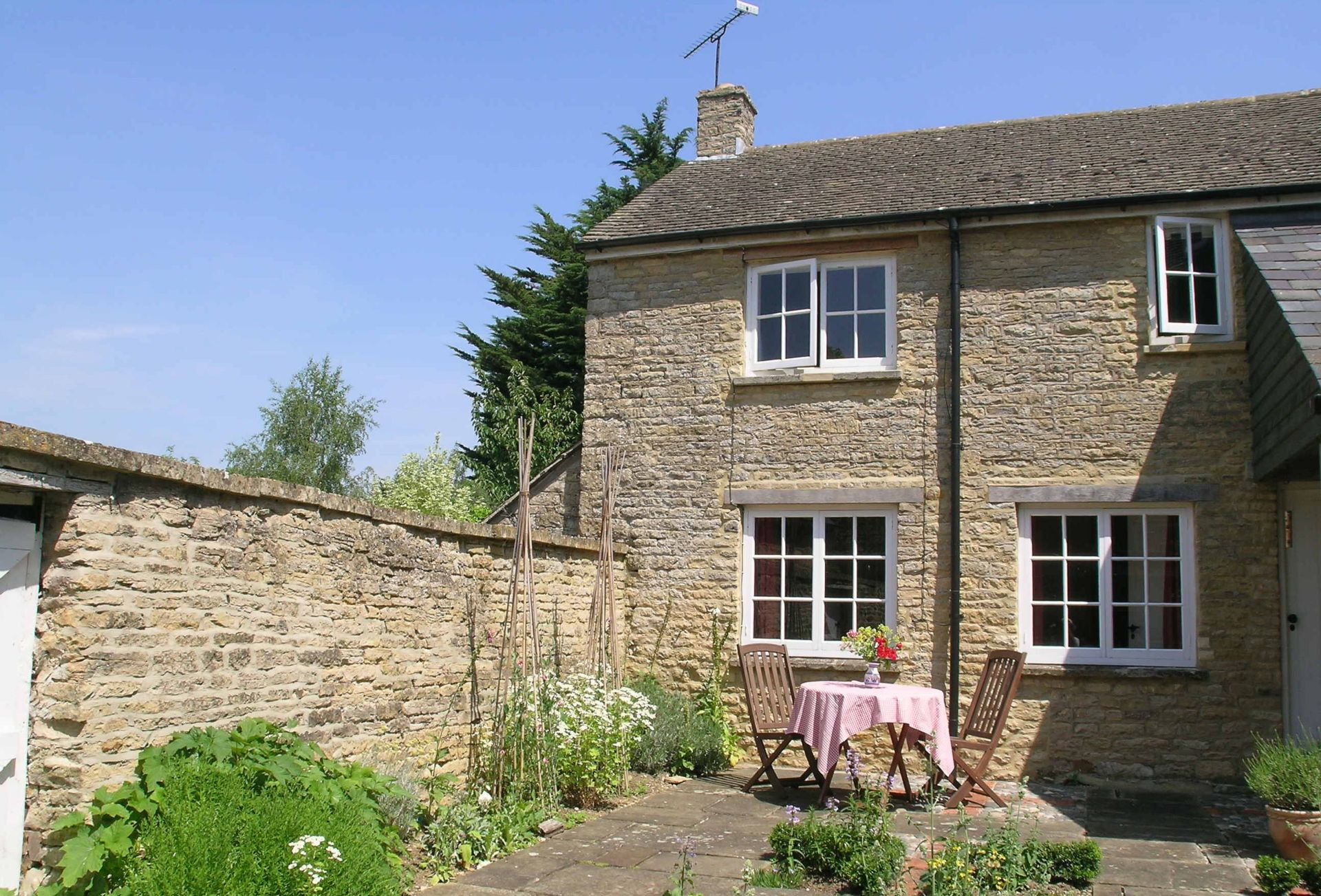Dairy Cottage looks out onto a walled garden, where an array of herbs can be found and used in your cooking