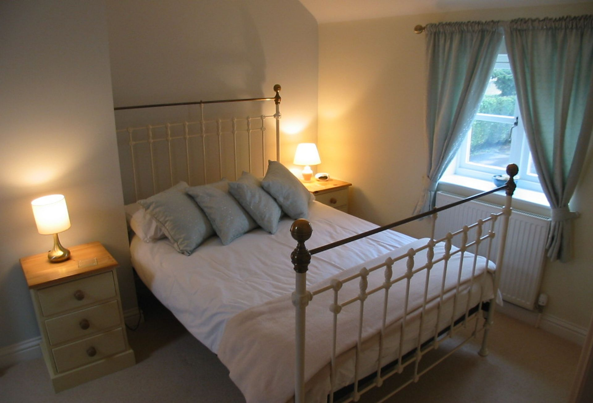 First floor: Bedroom one with double bed