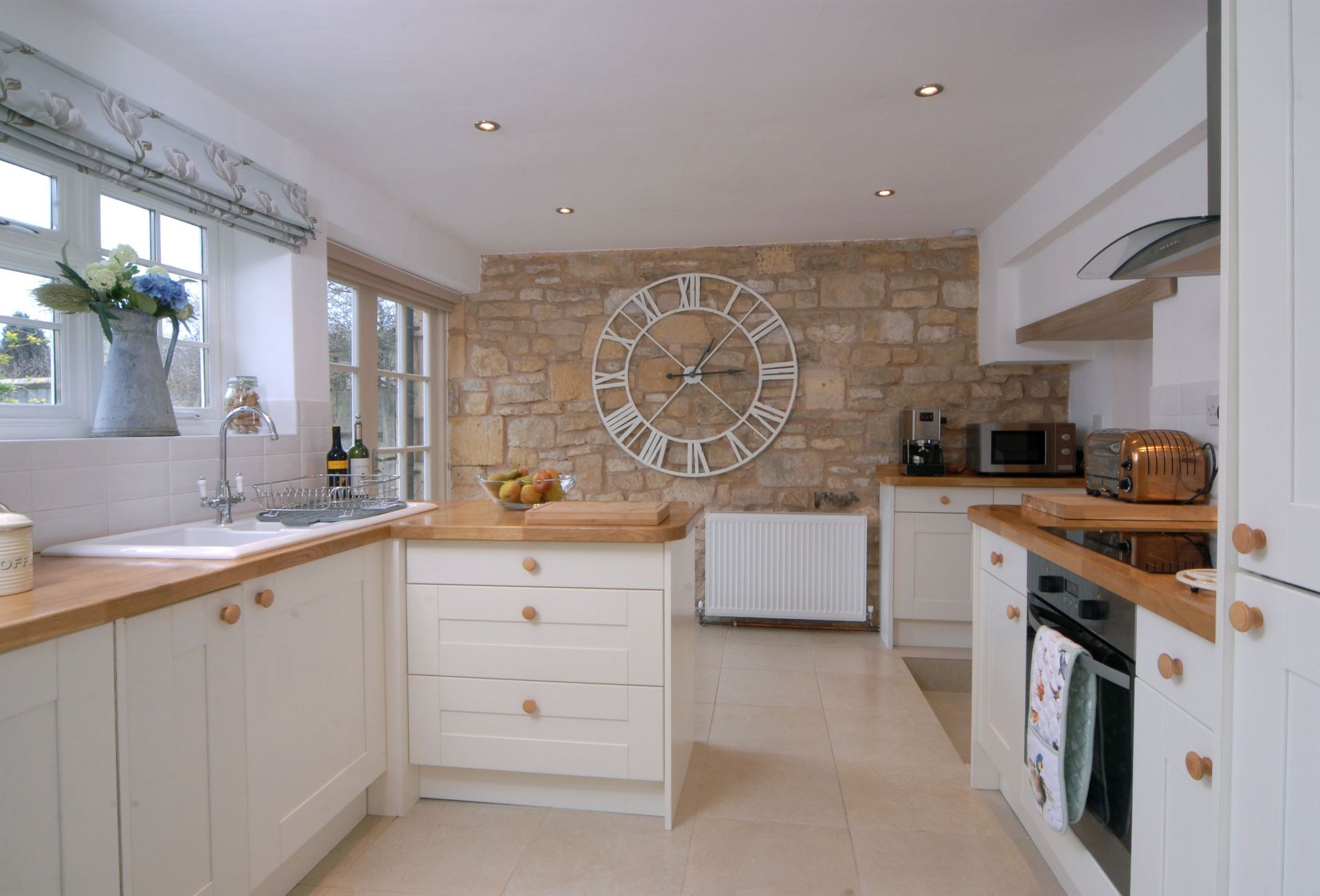 An exposed stone wall adds character to the Kitchen