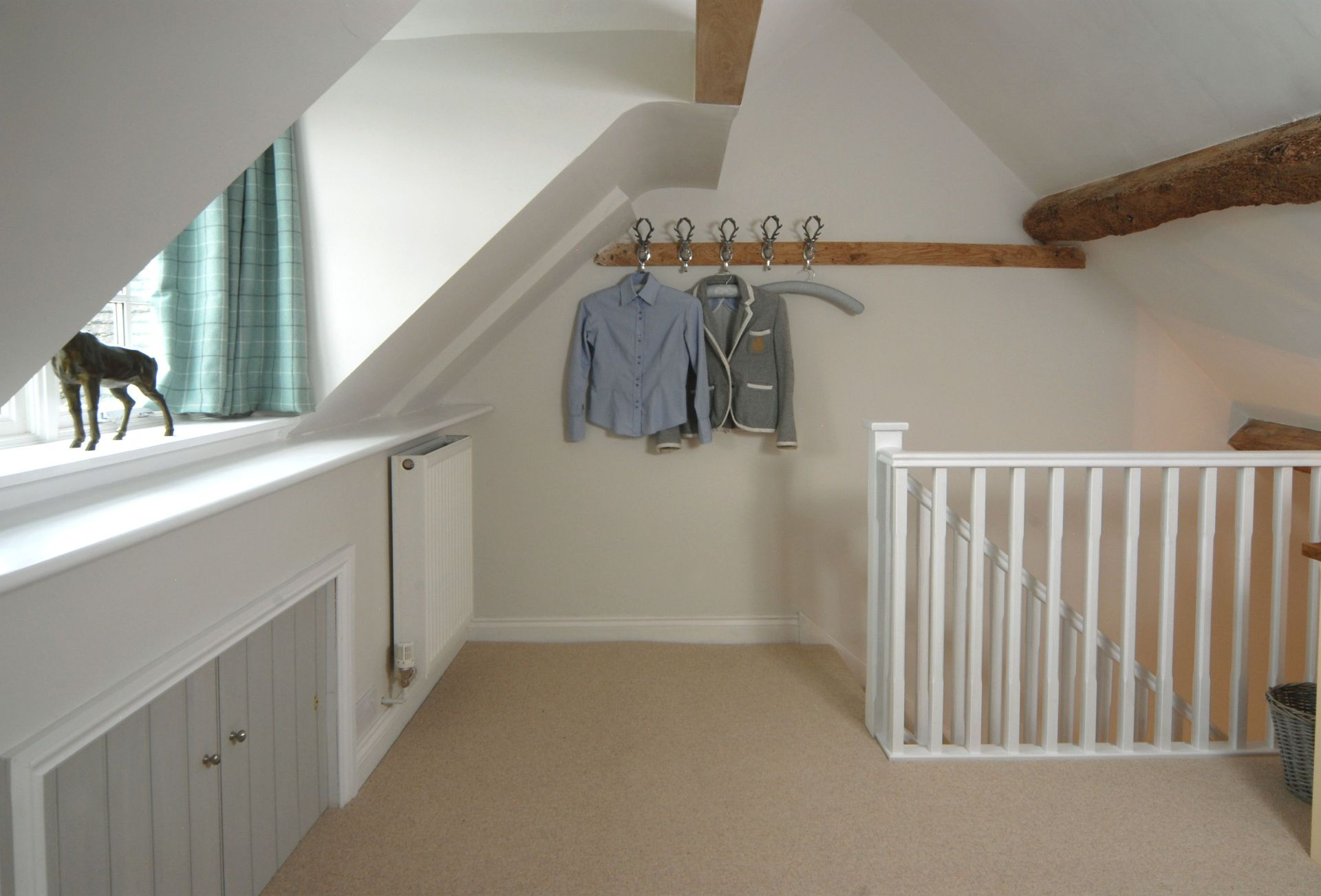 Second floor: The generous galleried dressing area with hanging space