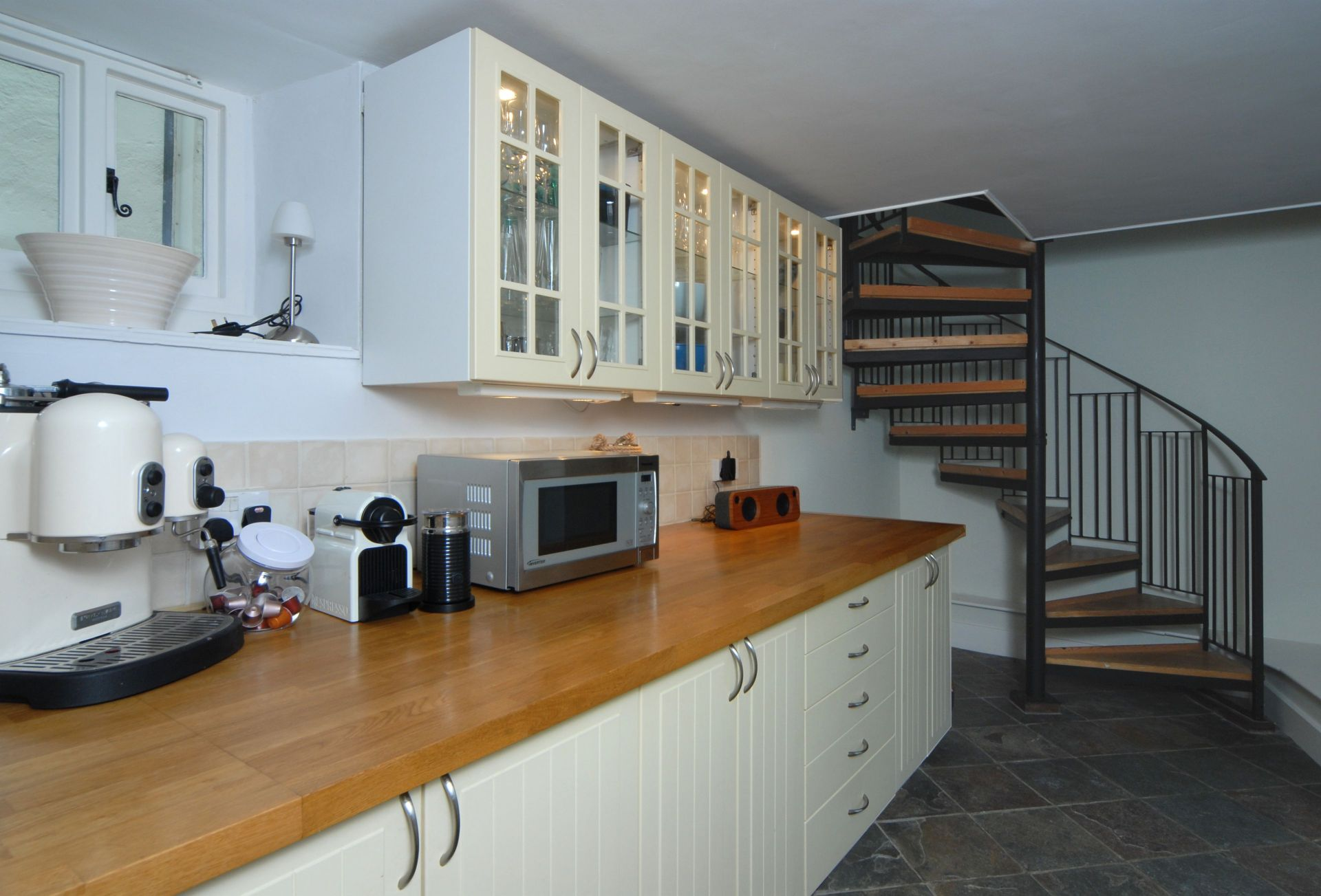 Ground floor: Kitchen with spiral staircase leading to the first floor
