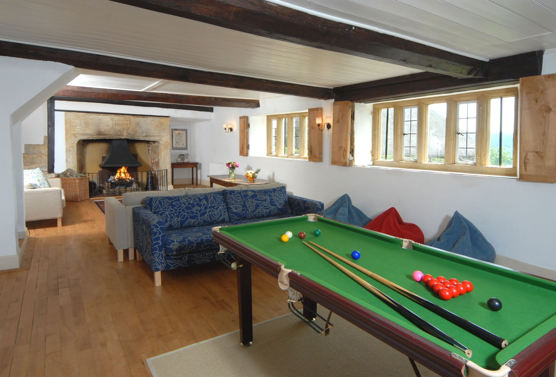 Ground floor: Sitting room - a view of the pool table looking towards the fireplace