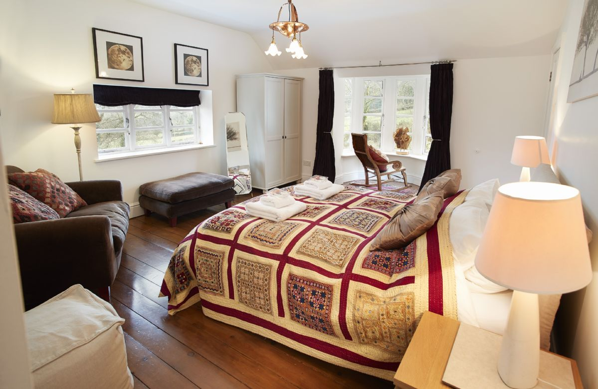 First floor: Oak bedroom with king size bed and en-suite shower