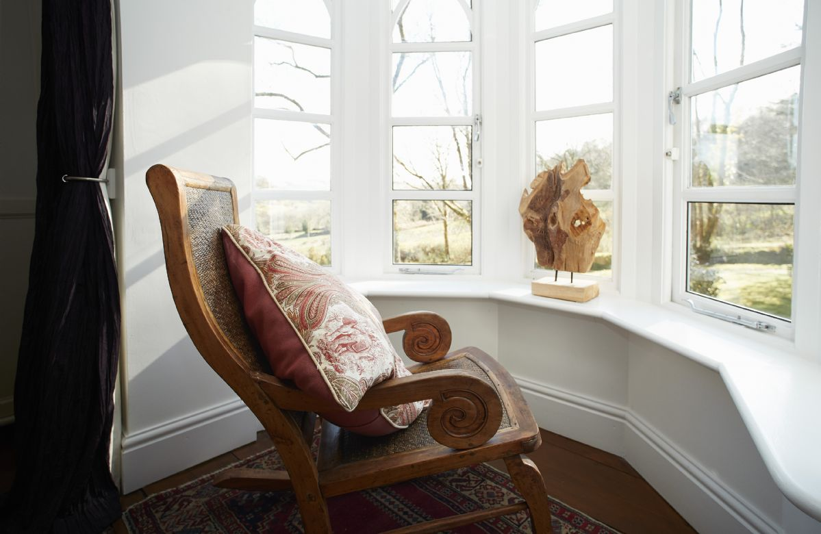 The Oak bedroom features a bay window looking on to woodland views