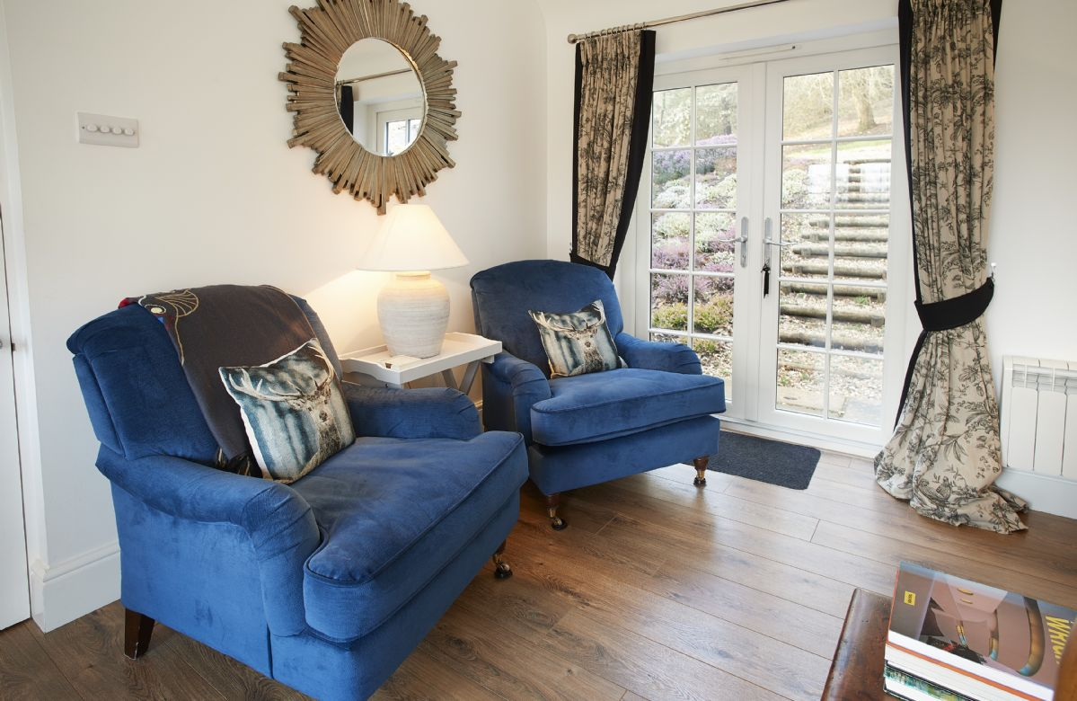 Ground floor: Sitting room with wood burning stove and two sets of French doors leading to the garden
