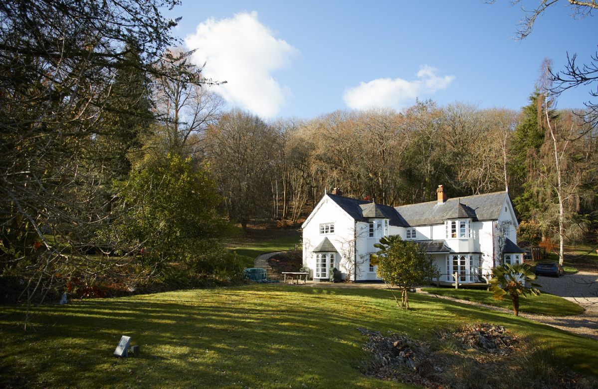 Set in six acres of woodland is this very special period home for family and friends