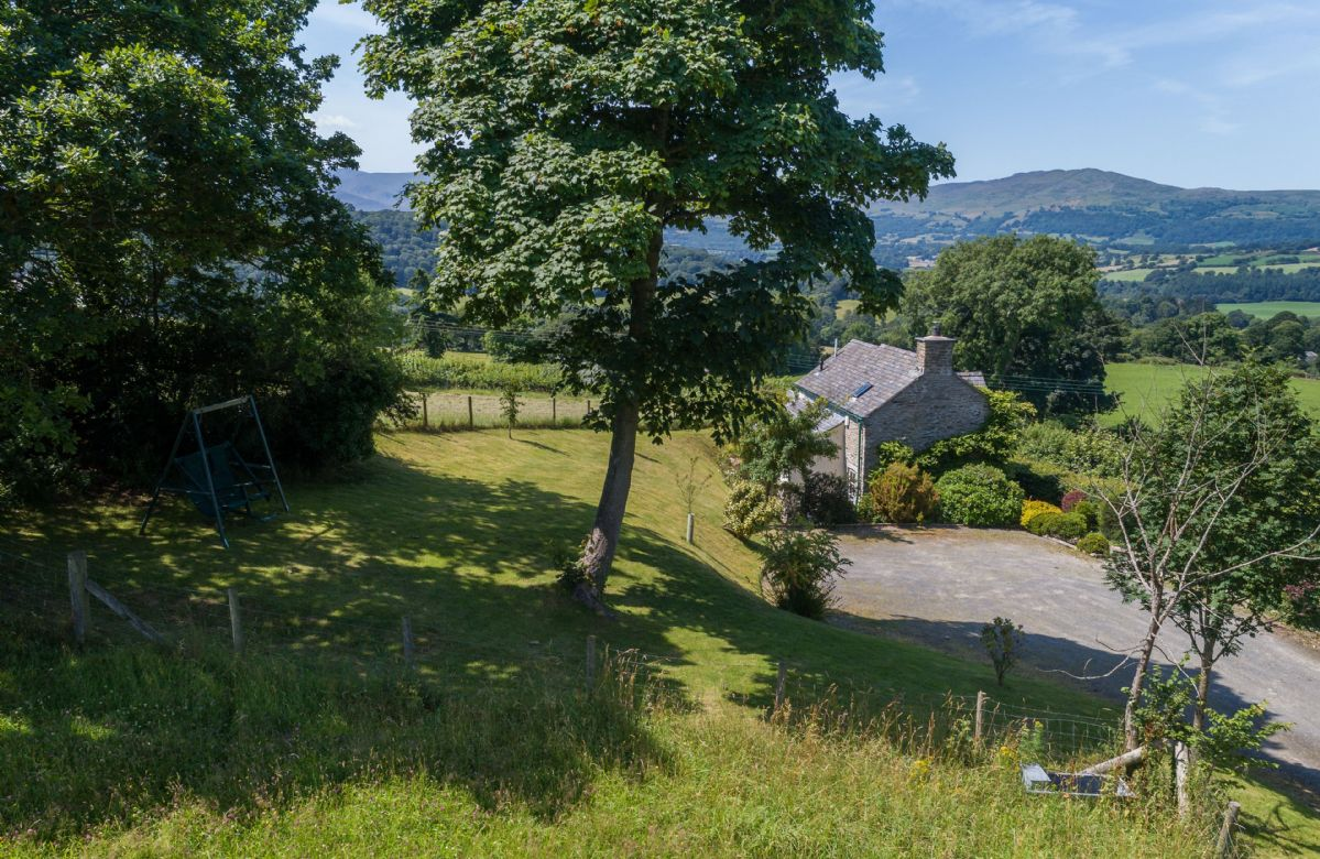 Ty Ucha'r Ffordd is one of seven luxury self catering holiday cottages on the Bodnant Estate near Conwy in North Wales