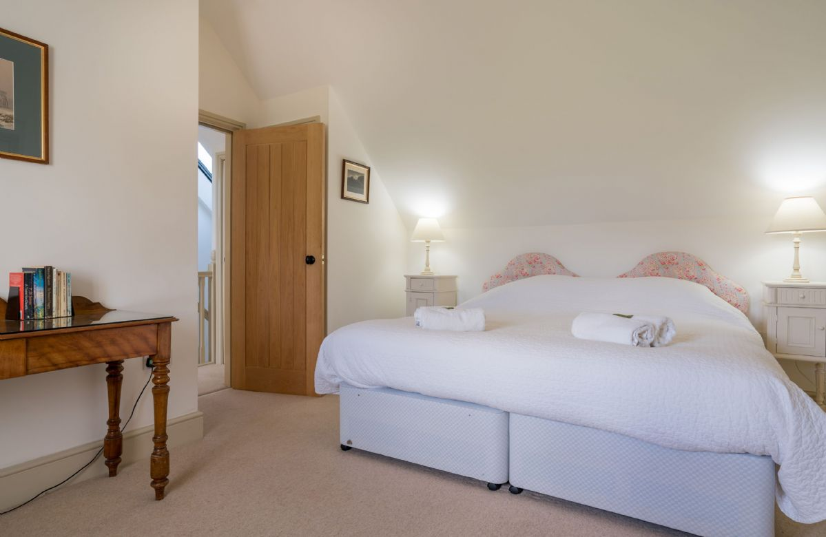 First floor: Twin bedroom with two 3' zip and link beds which can convert to 6' double upon request with en-suite bathroom