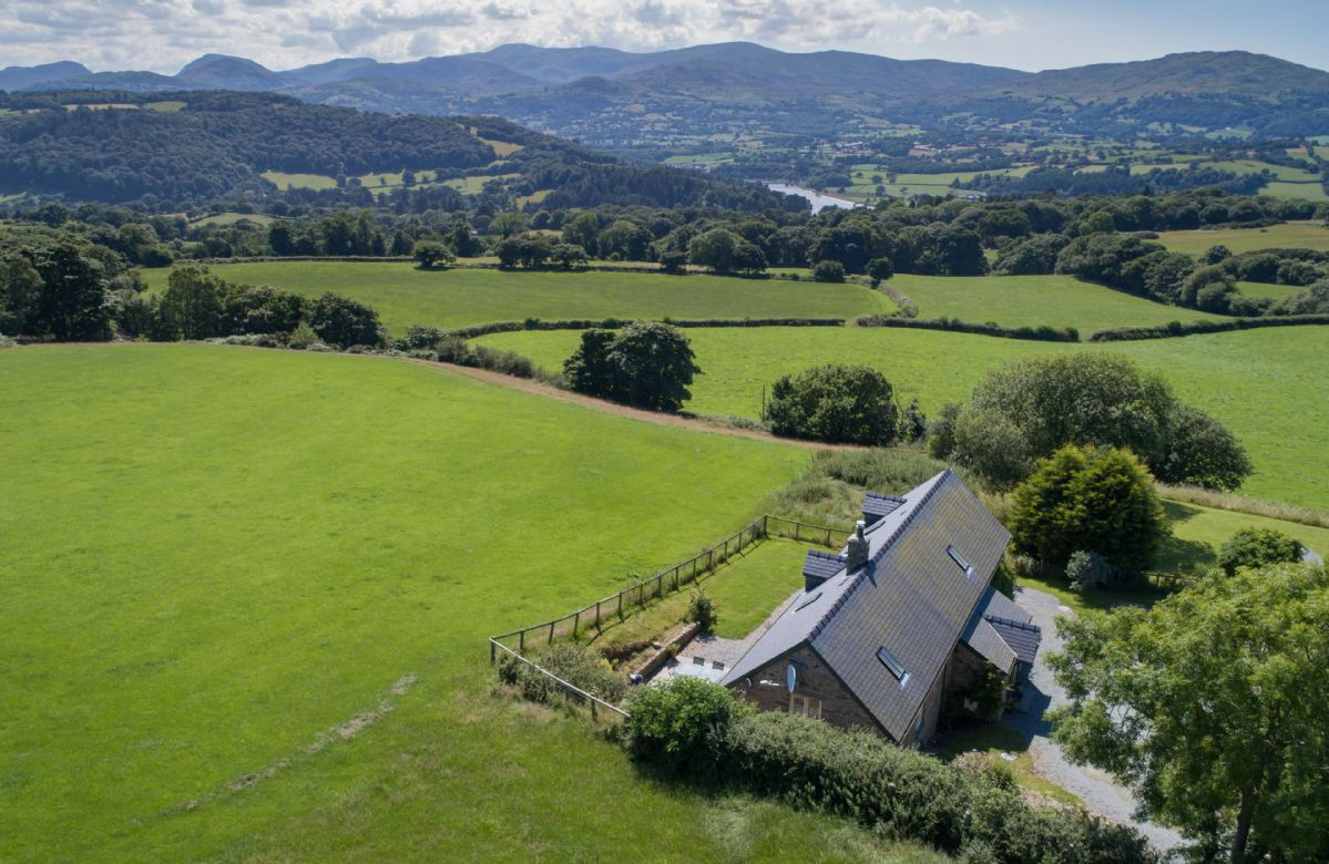 The property commands spectacular and panoramic views of the Carneddau mountains (Snowdonia National Park).