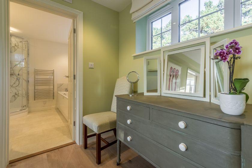 Ground floor: En-suite bathroom with bath and walk in shower