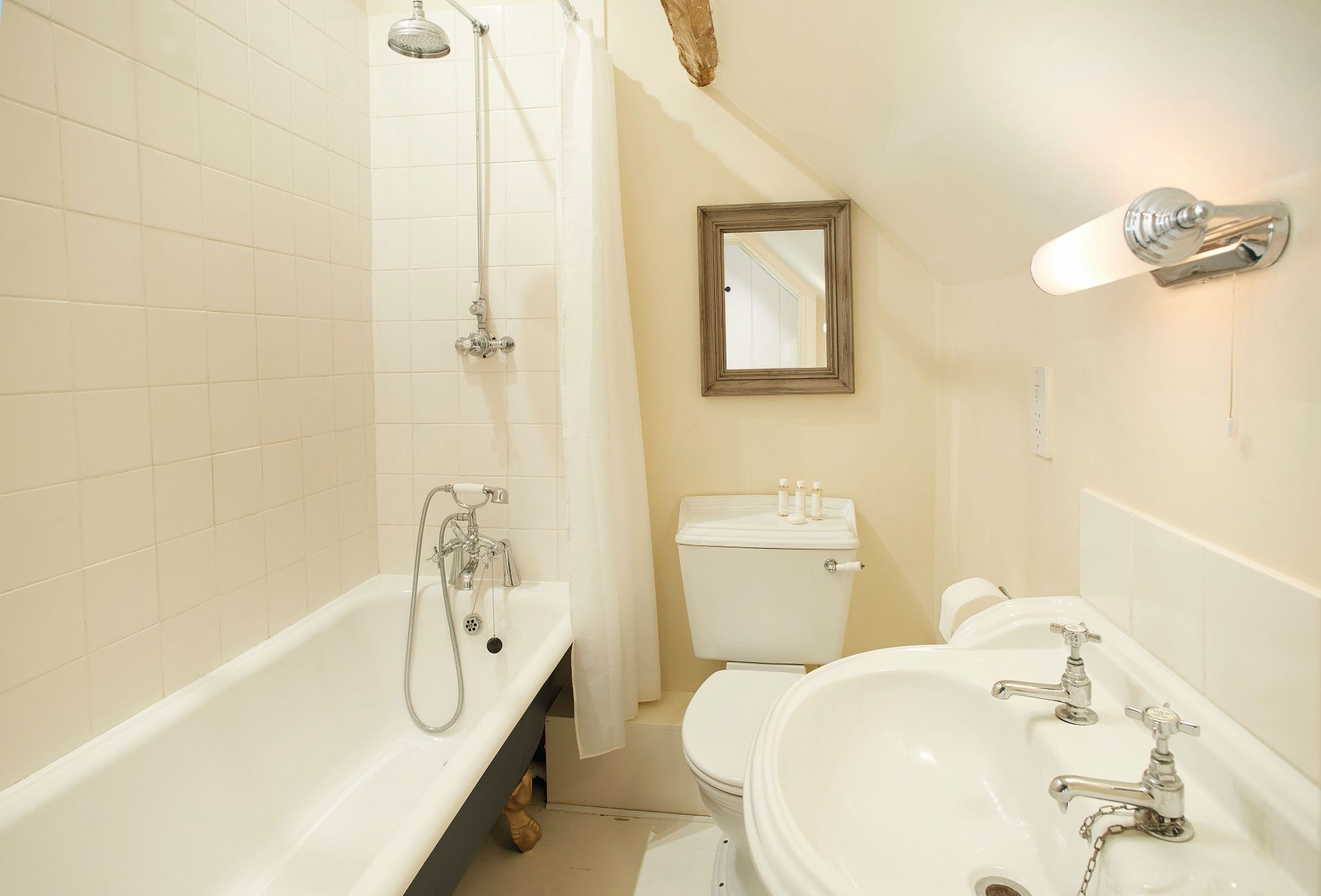 First floor: Family bathroom with roll top bath and overhead shower