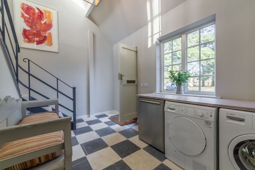 Ground floor: Entrance hall with washing machine, tumble dryer and freezer