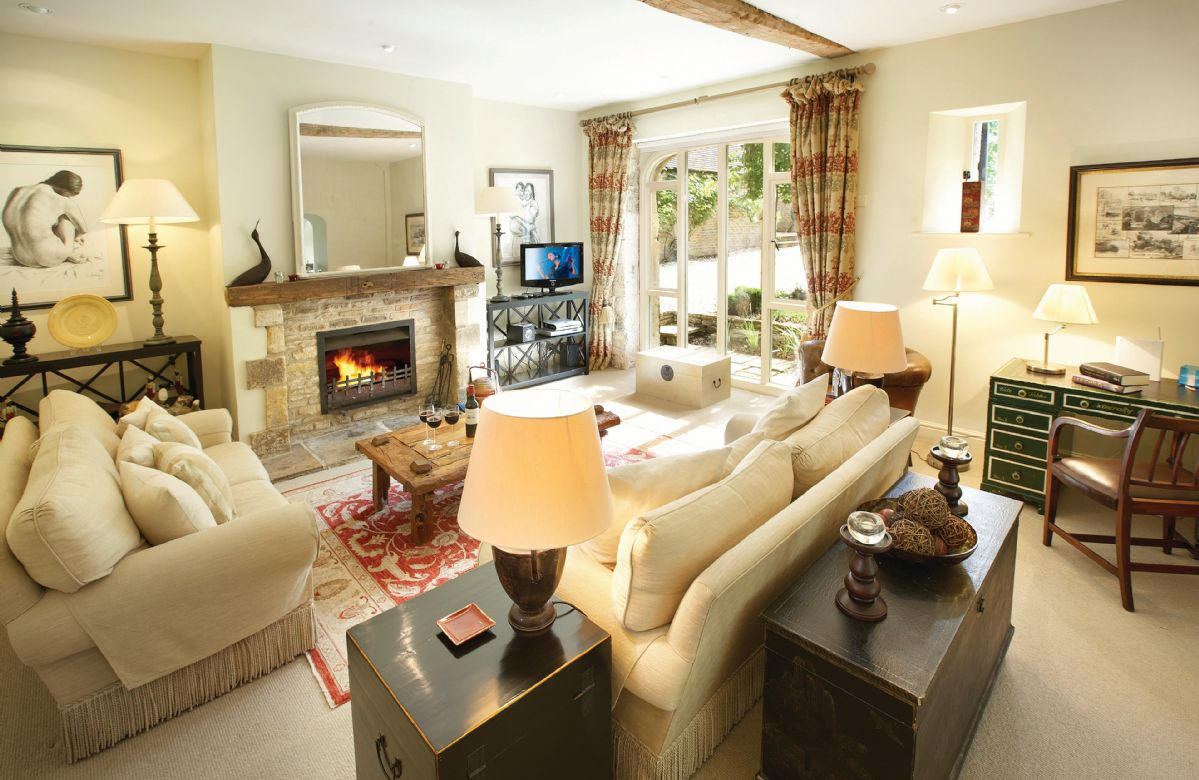 Ground floor: Open-plan sitting room with open fire, dining and kitchen