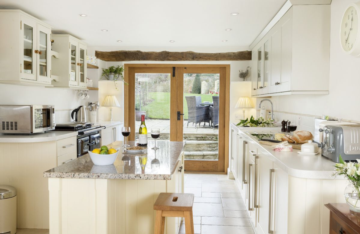 Ground floor: Kitchen with French doors to the garden and outdoor dining area