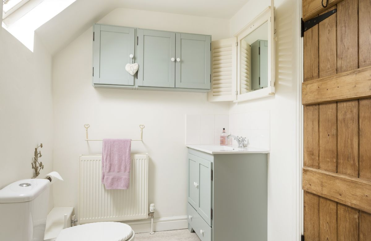 First floor: Family bathroom with bath and overhead shower