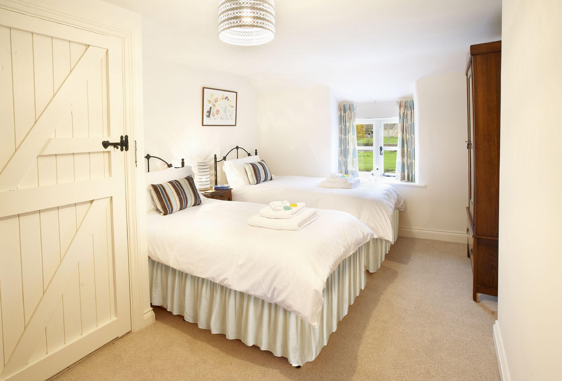 First floor: Twin bedroom with 3ft beds and en-suite bathroom with shower