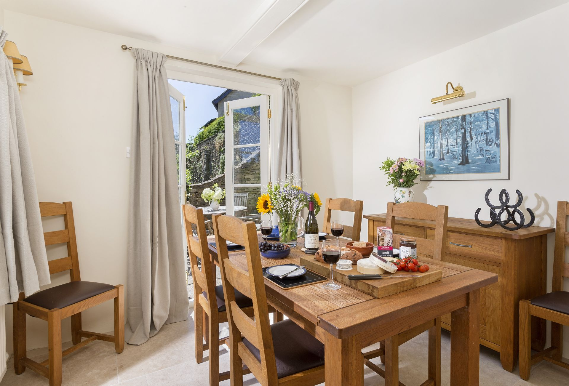 Ground floor: Dining room with French doors to patio and garden