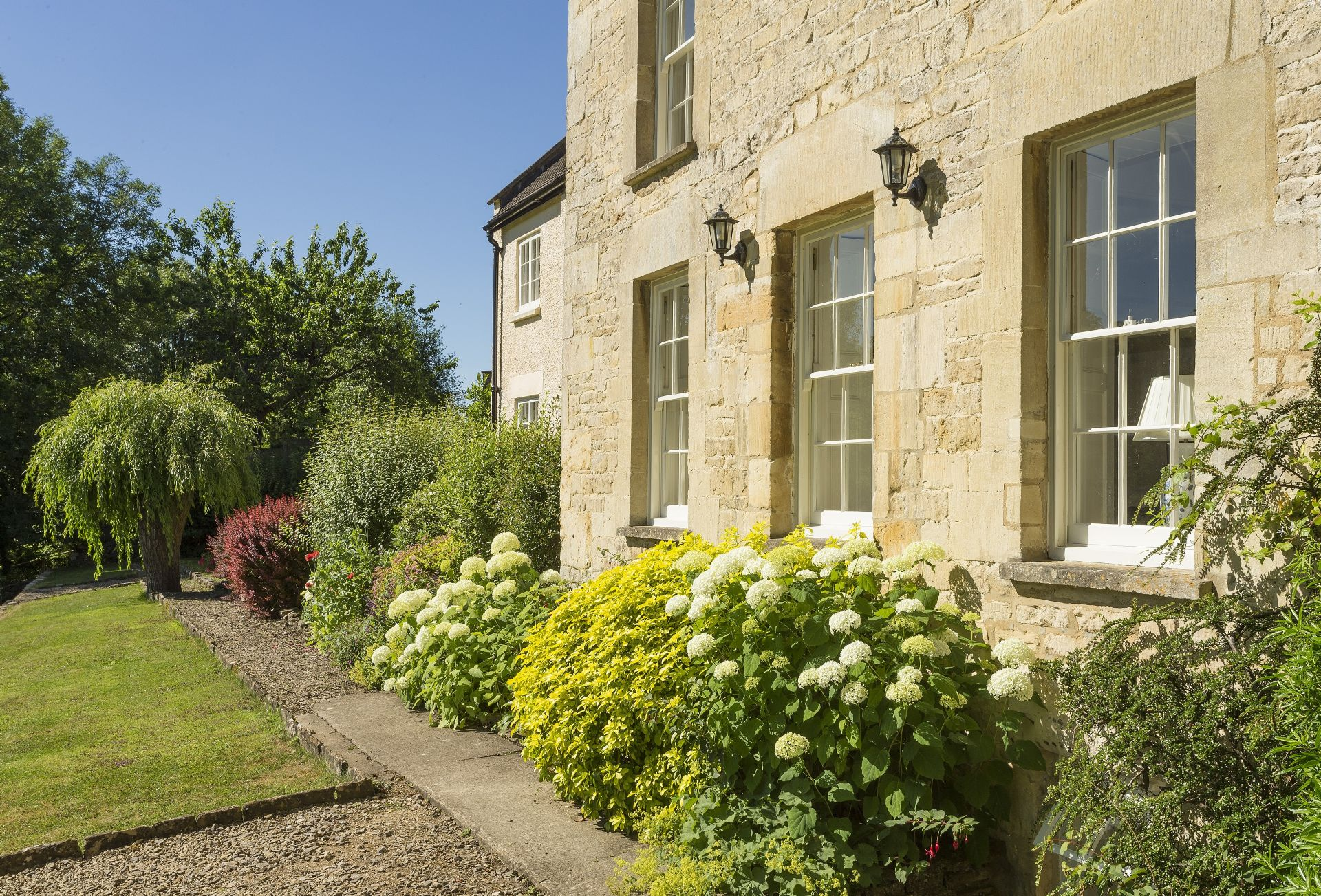 Beautiful gardens surround Catalpa Cottage