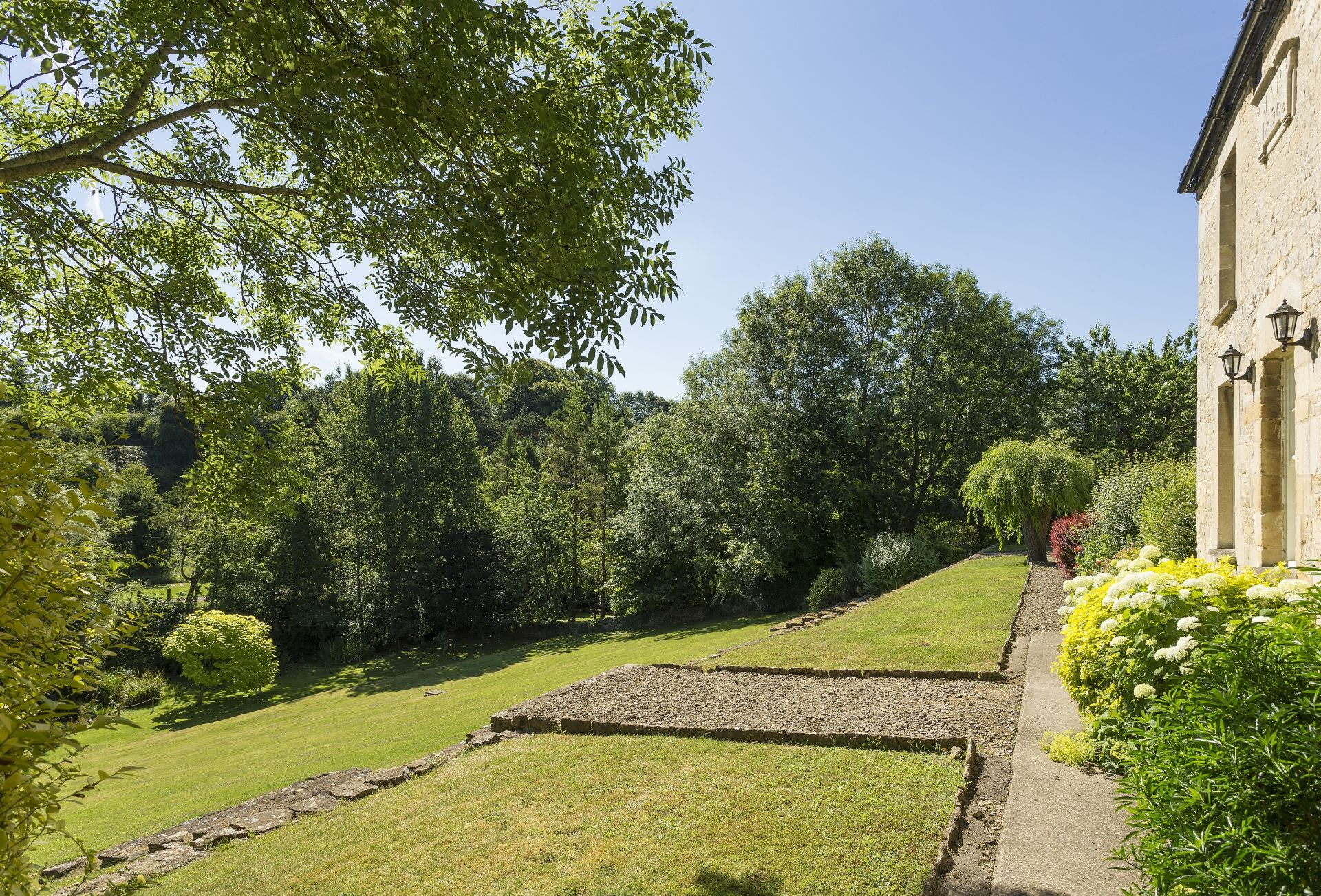 Charming, large garden including sloping lawn and two ponds (unfenced, please ensure children are supervised)