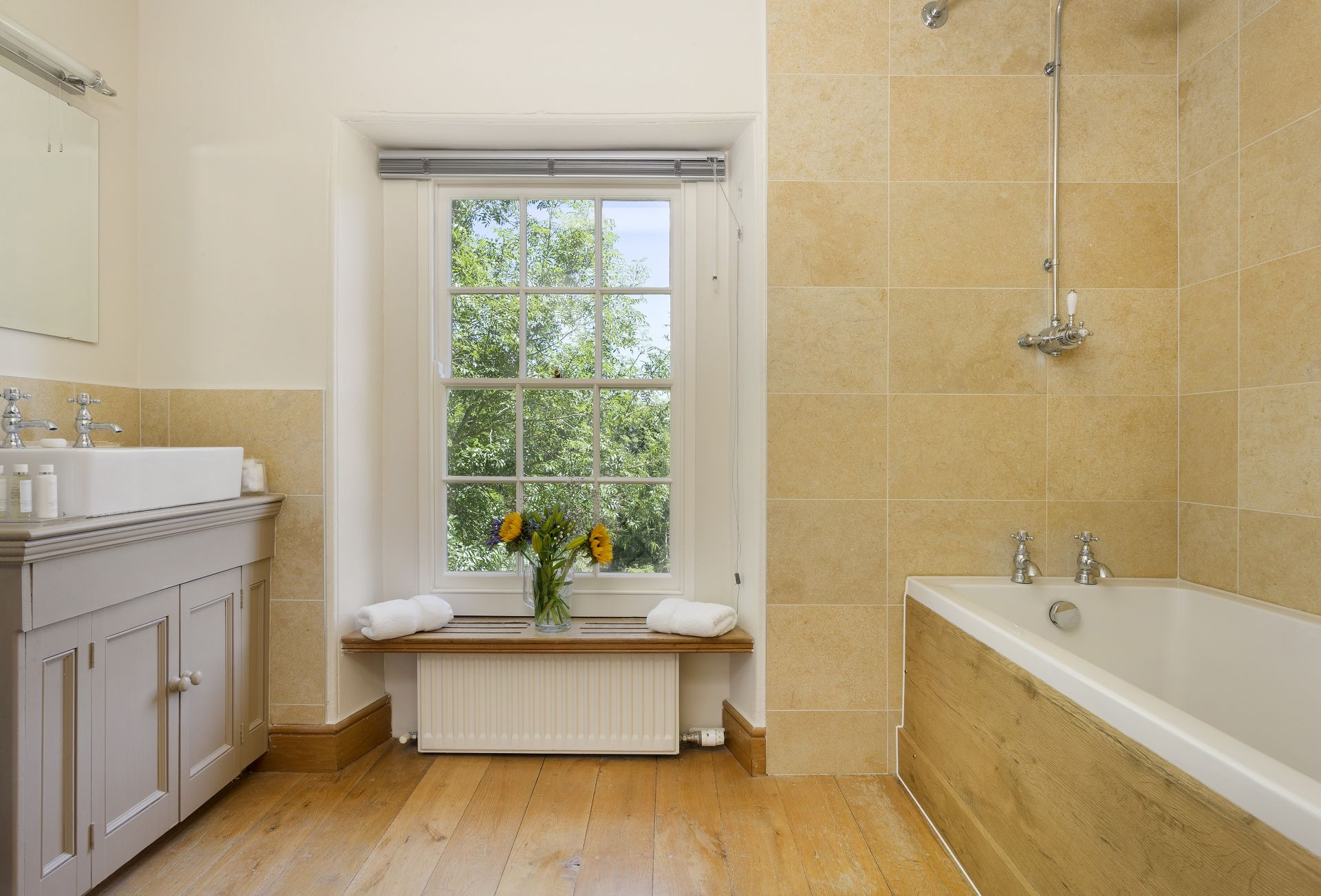 First floor: Bathroom with shower over bath and wc