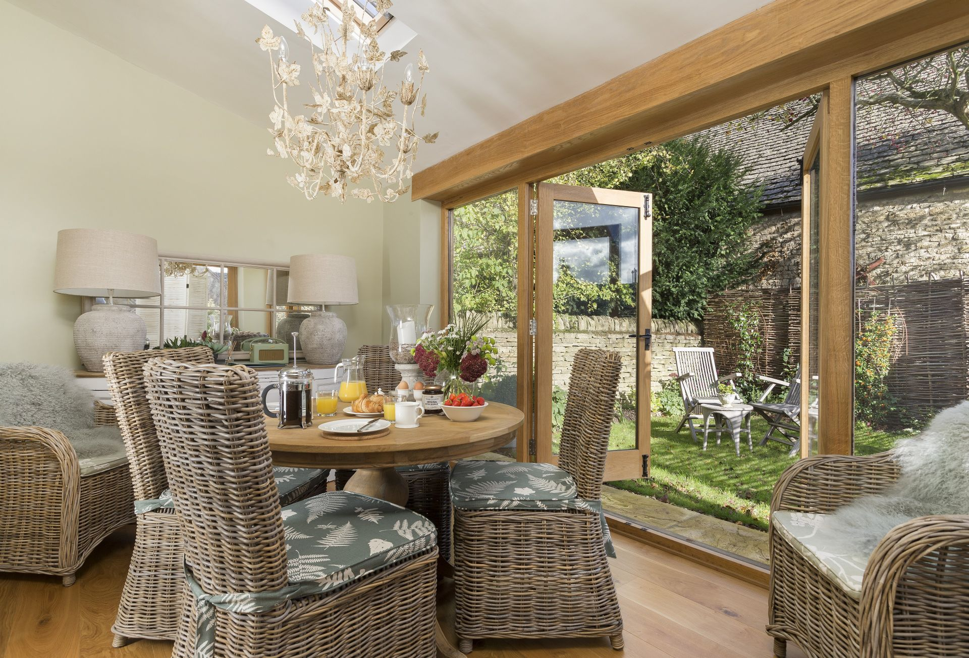 Ground floor: Garden room with dining table and french doors opening on the private patio and enclosed garden