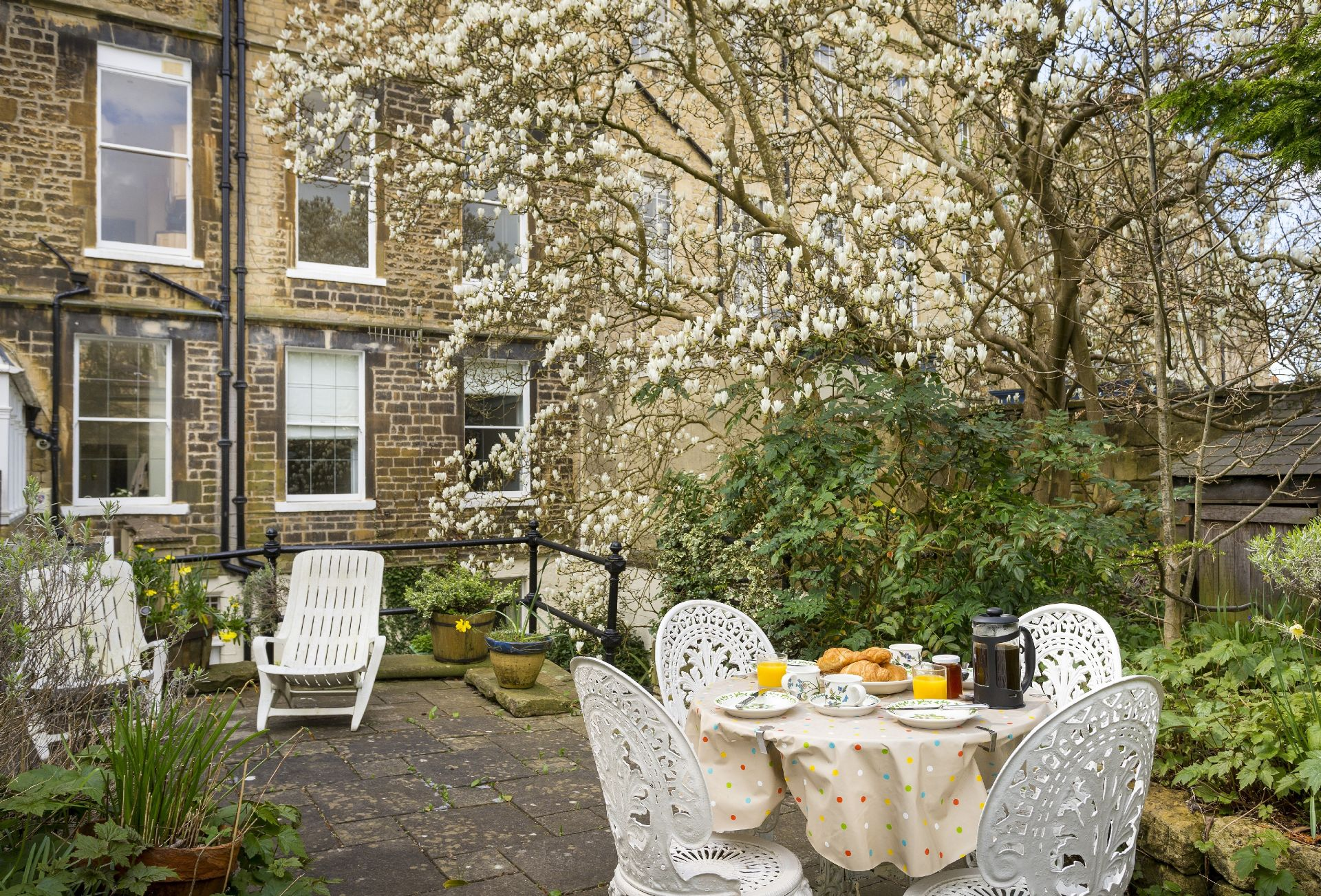 Very large patio with al fresco dining area, and raised terrace garden to rear with access from hall and twin bedroom