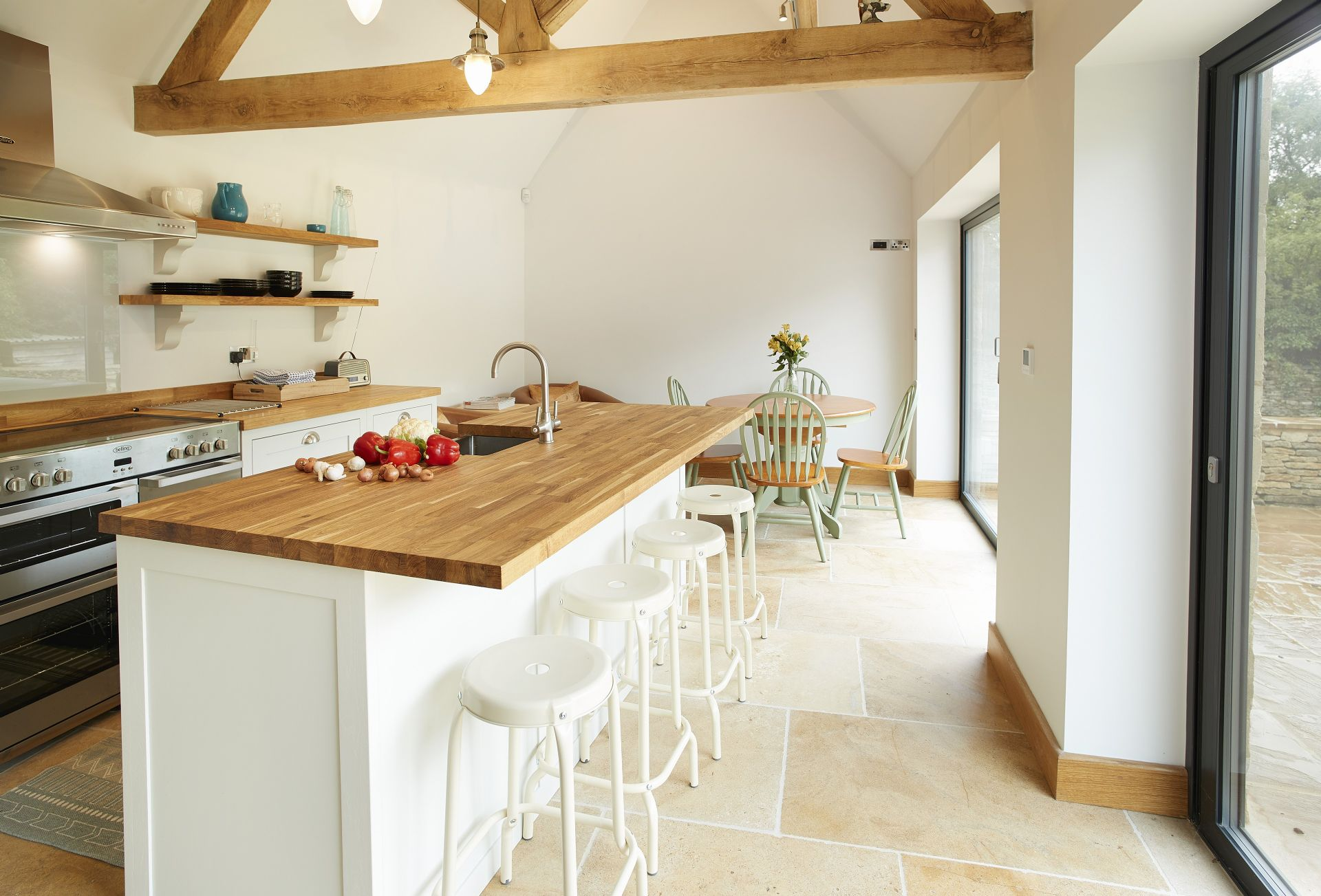 Ground floor: Vaulted oak beamed kitchen/diner with bi-fold doors that open out onto  a patio and large enclosed garden