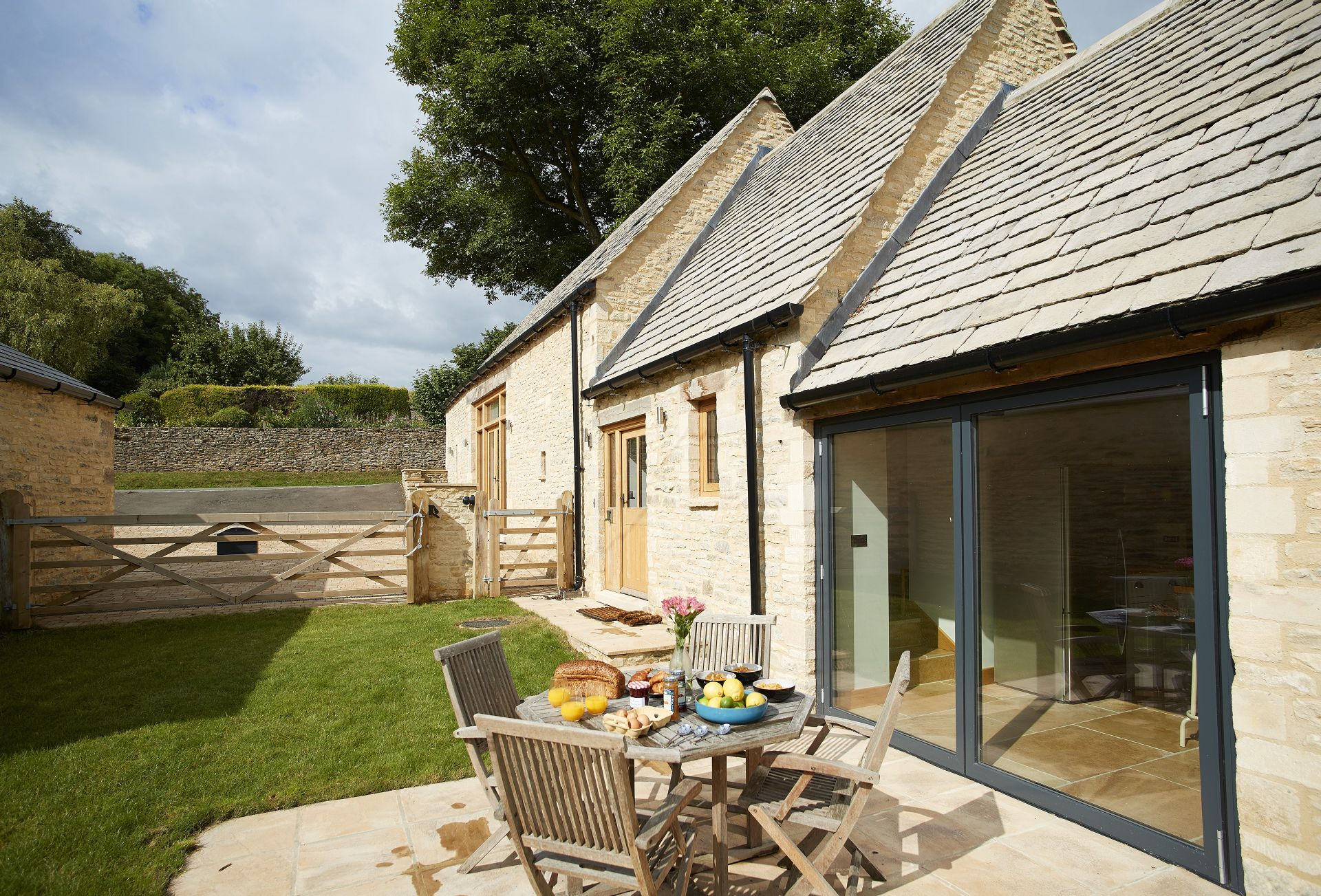 The bi-fold doors from the kitchen open out onto a charming patio and enclosed lawned garden with views on to open countryside