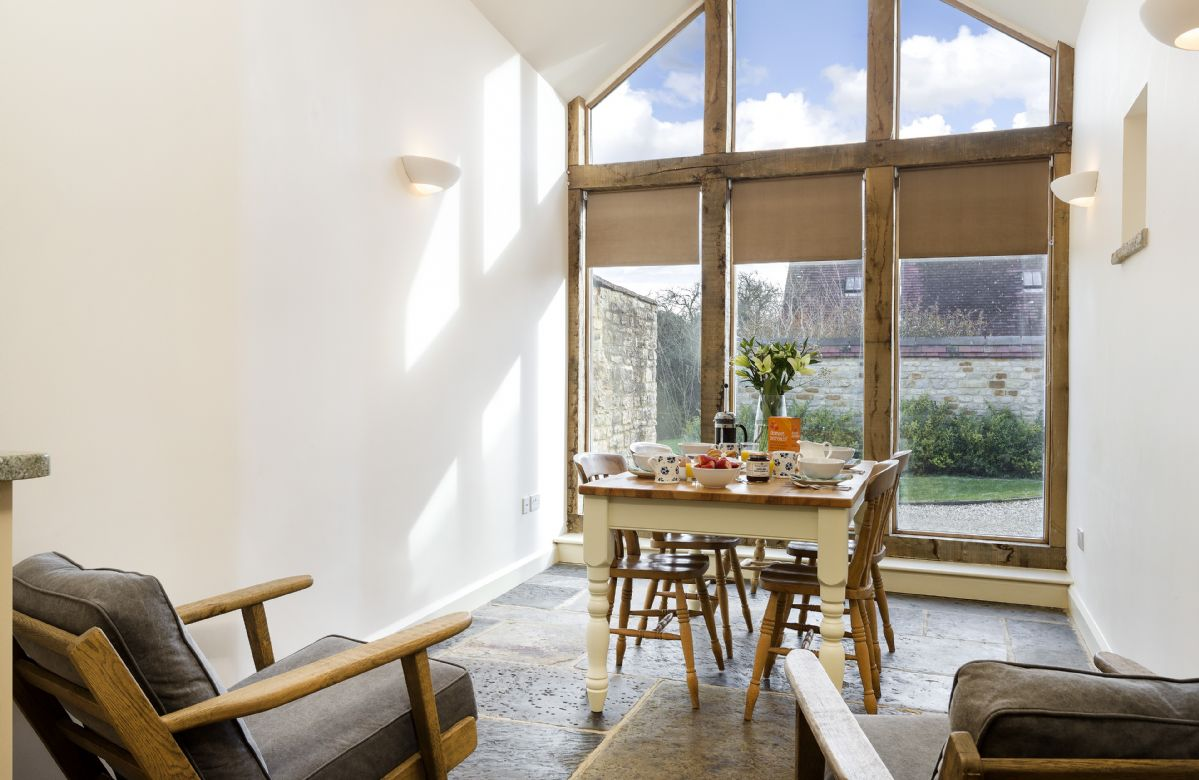 Ground floor: Dining area with vaulted ceiling
