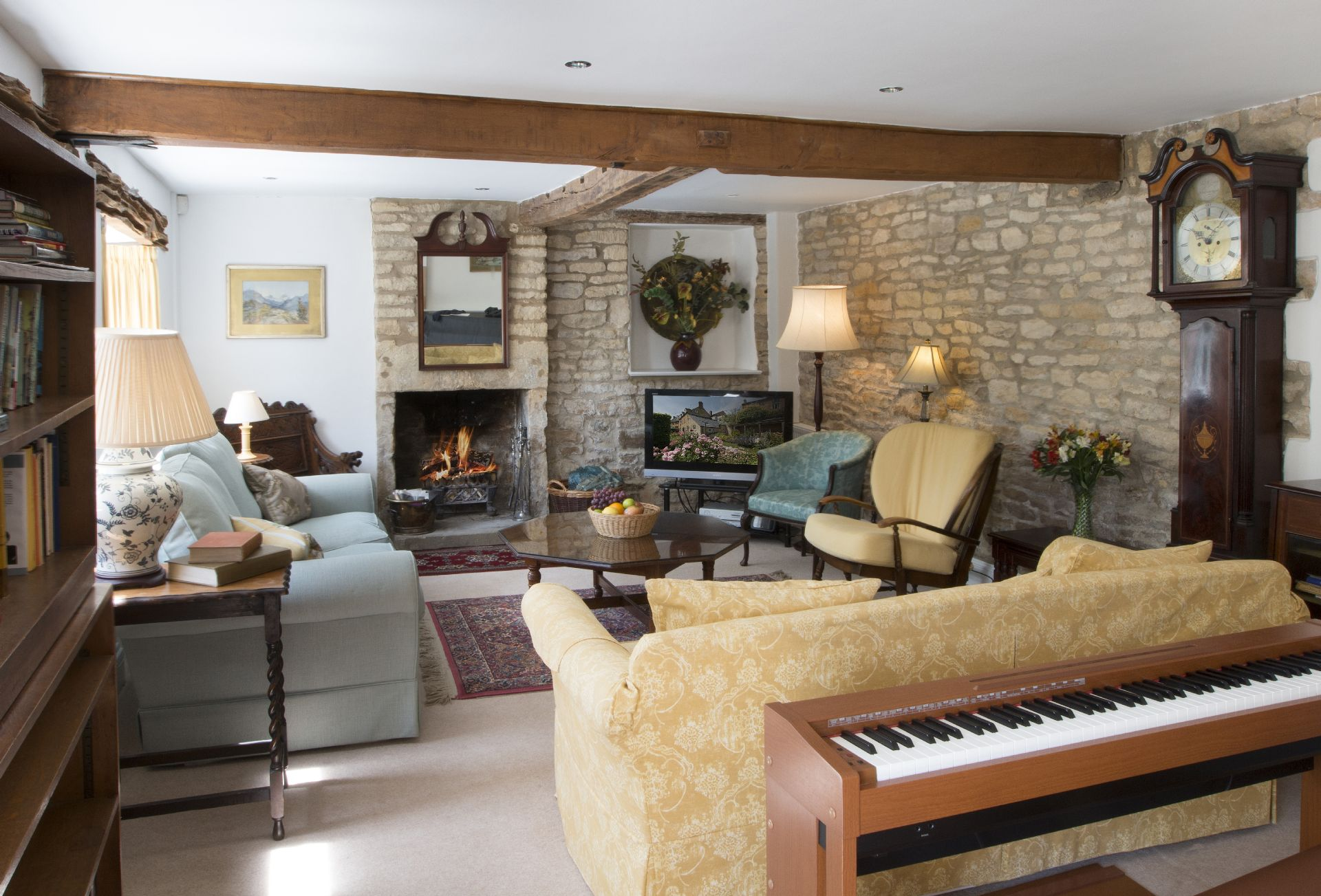 Lower ground floor: Large spacious sitting room, with French windows to the garden and open fire