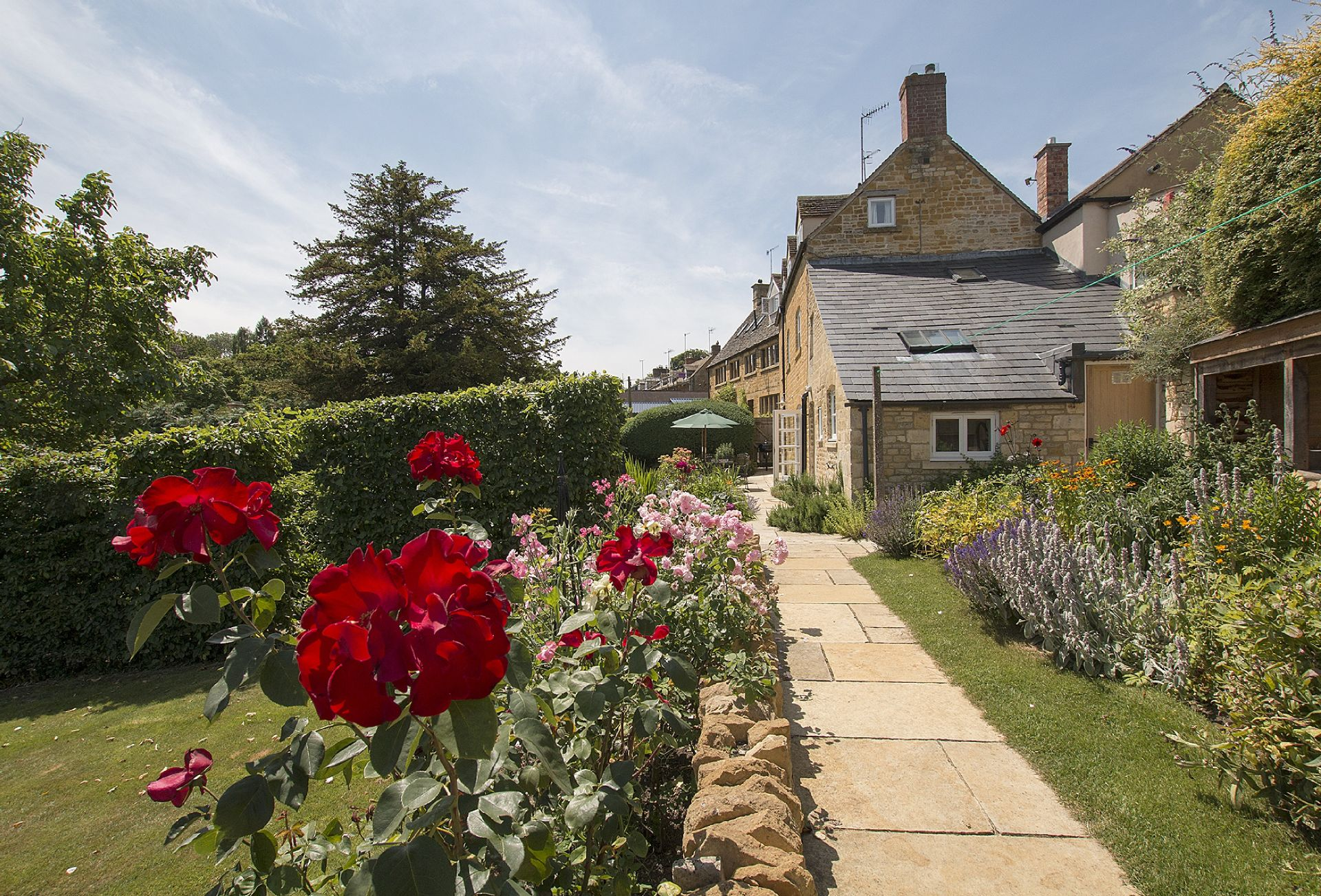 Large, enclosed garden with attractive herbaceous bedding
