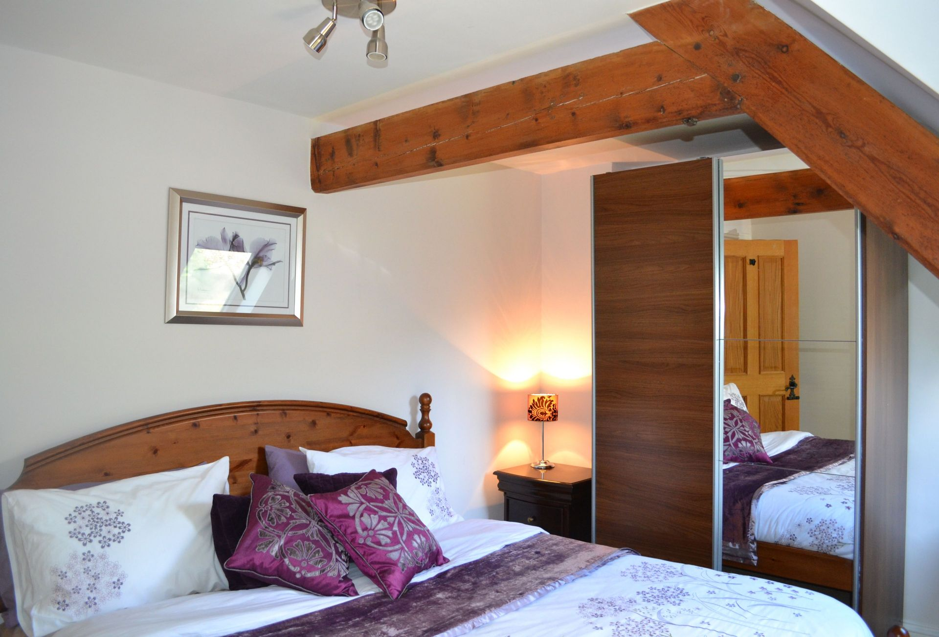 First floor:  Master bedroom with king-size bed