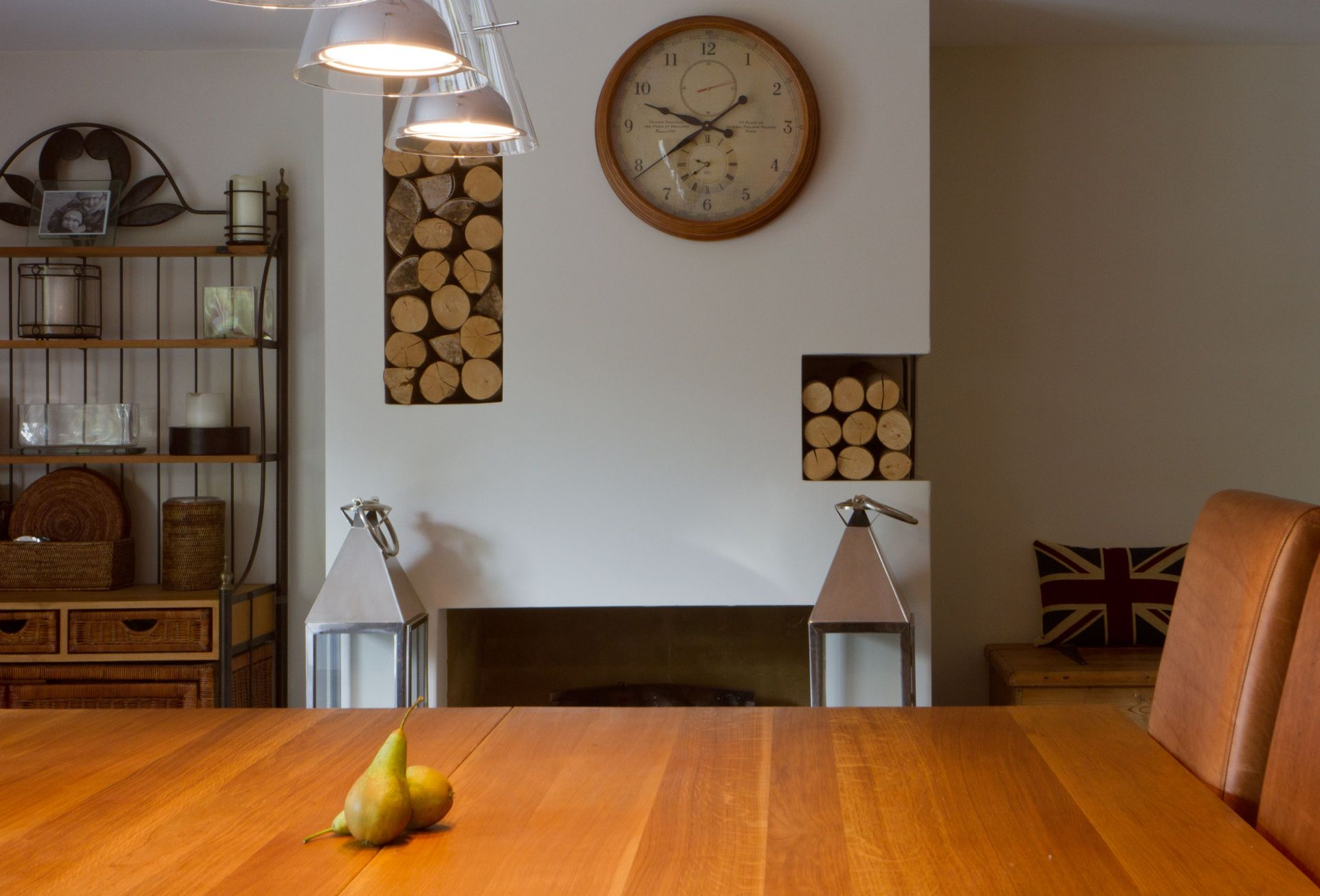 Ground floor:  Dining area with large oak table with plenty of seating in front of an open fire