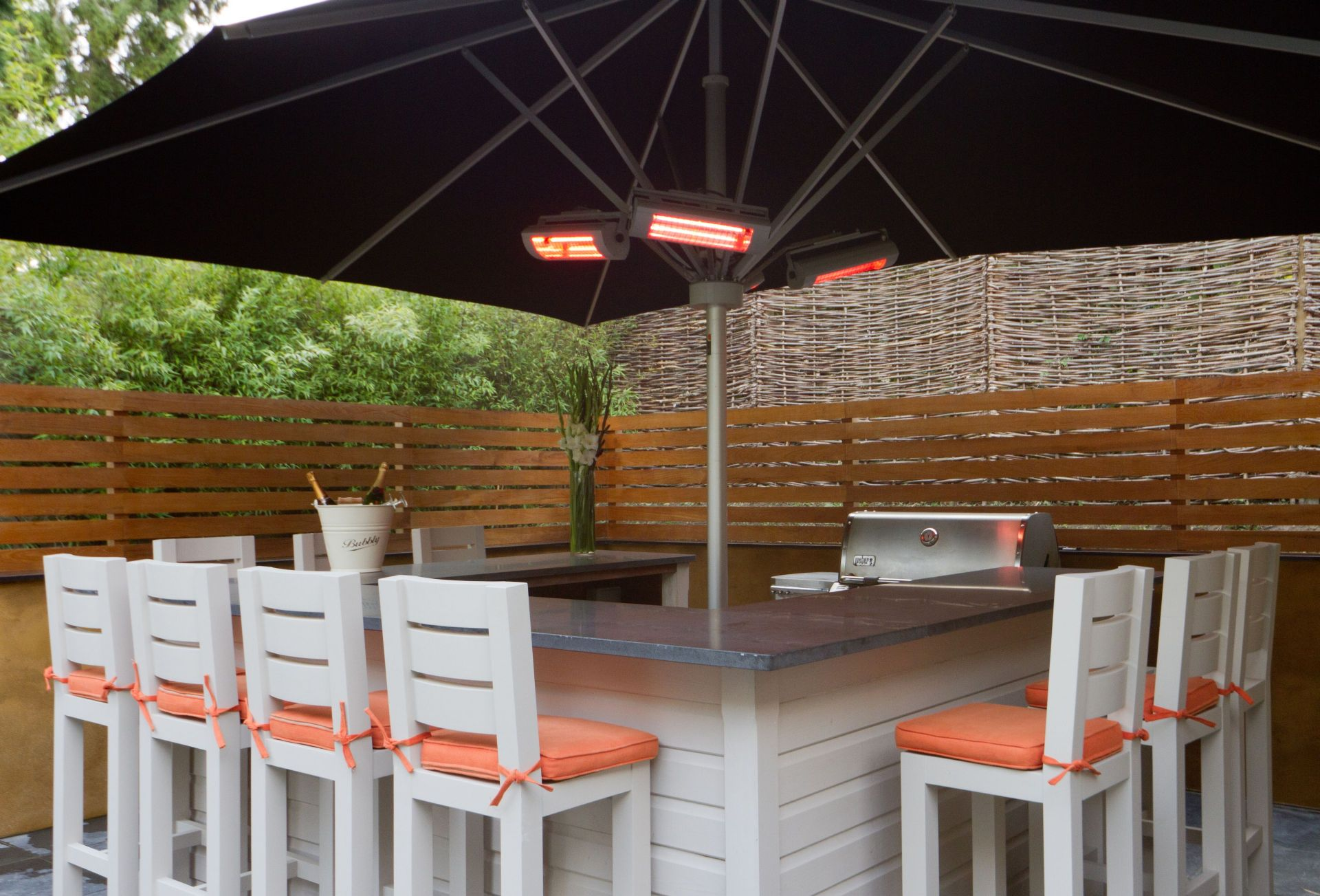 Outside:  An outdoor gas fire as well as a bar area with stools, two butler sinks, a large stainless drinks cooler and a gas barbecue