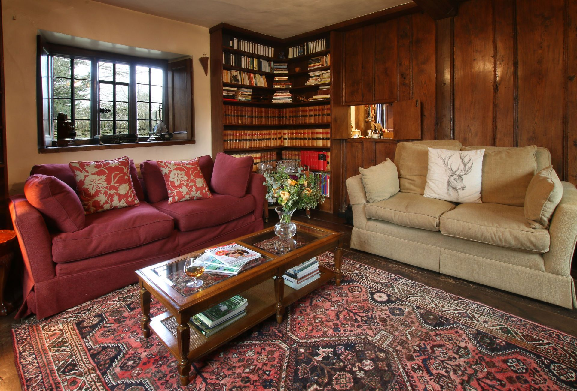 Ground floor:  Wood panelled library with dual aspect views