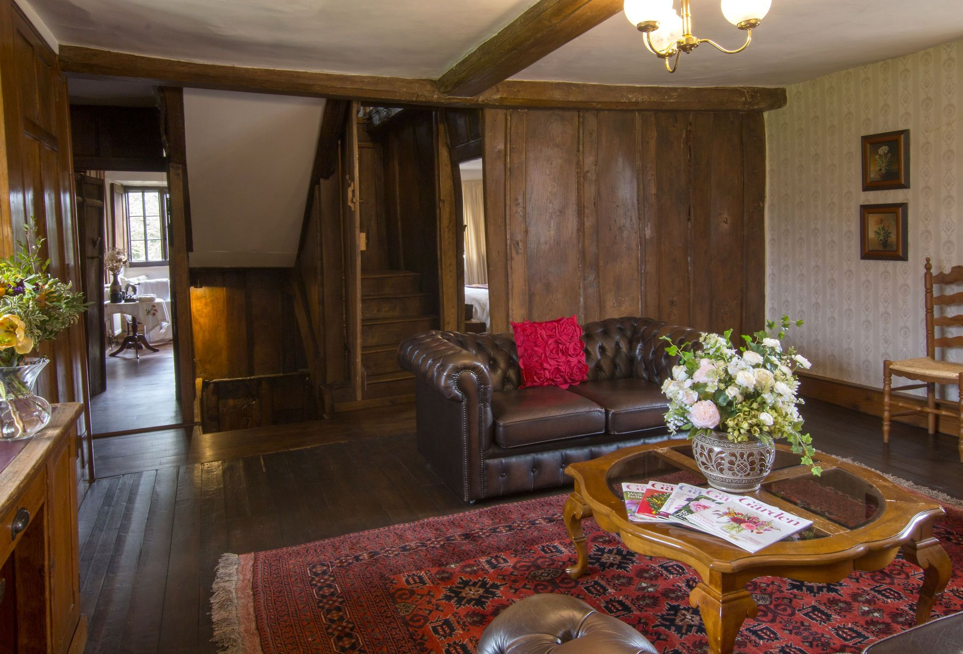Ground floor:  A door in the panelling opens to the wooden staircase