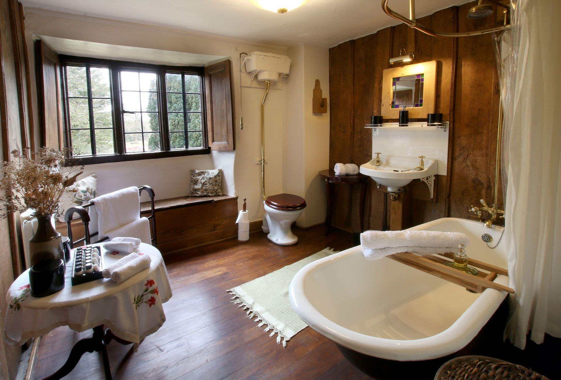 First floor:  Adjacent bathroom with claw foot bath and overhead rain shower
