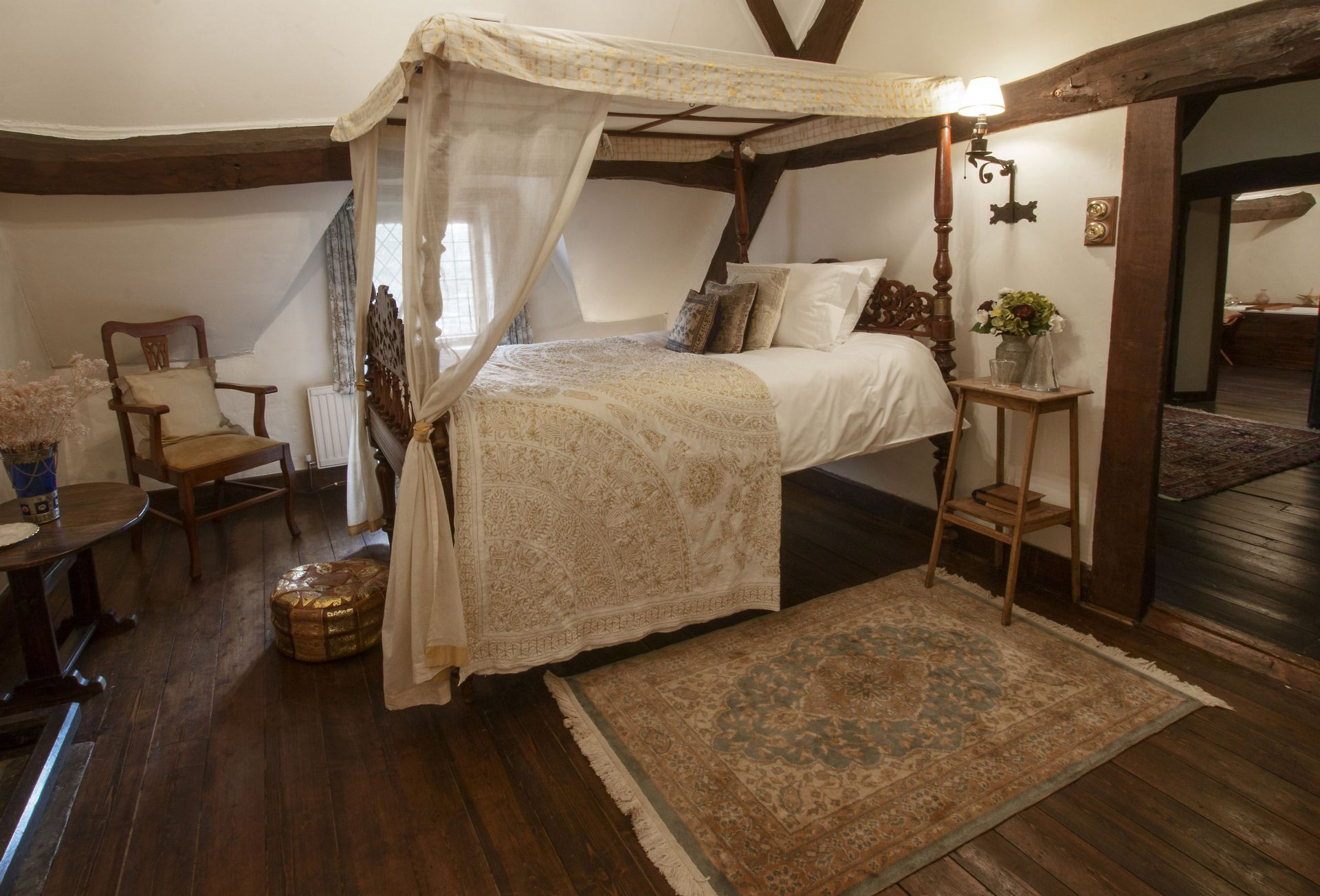 Second floor:  Bedroom five with antique, over-sized single four-poster Indian bed