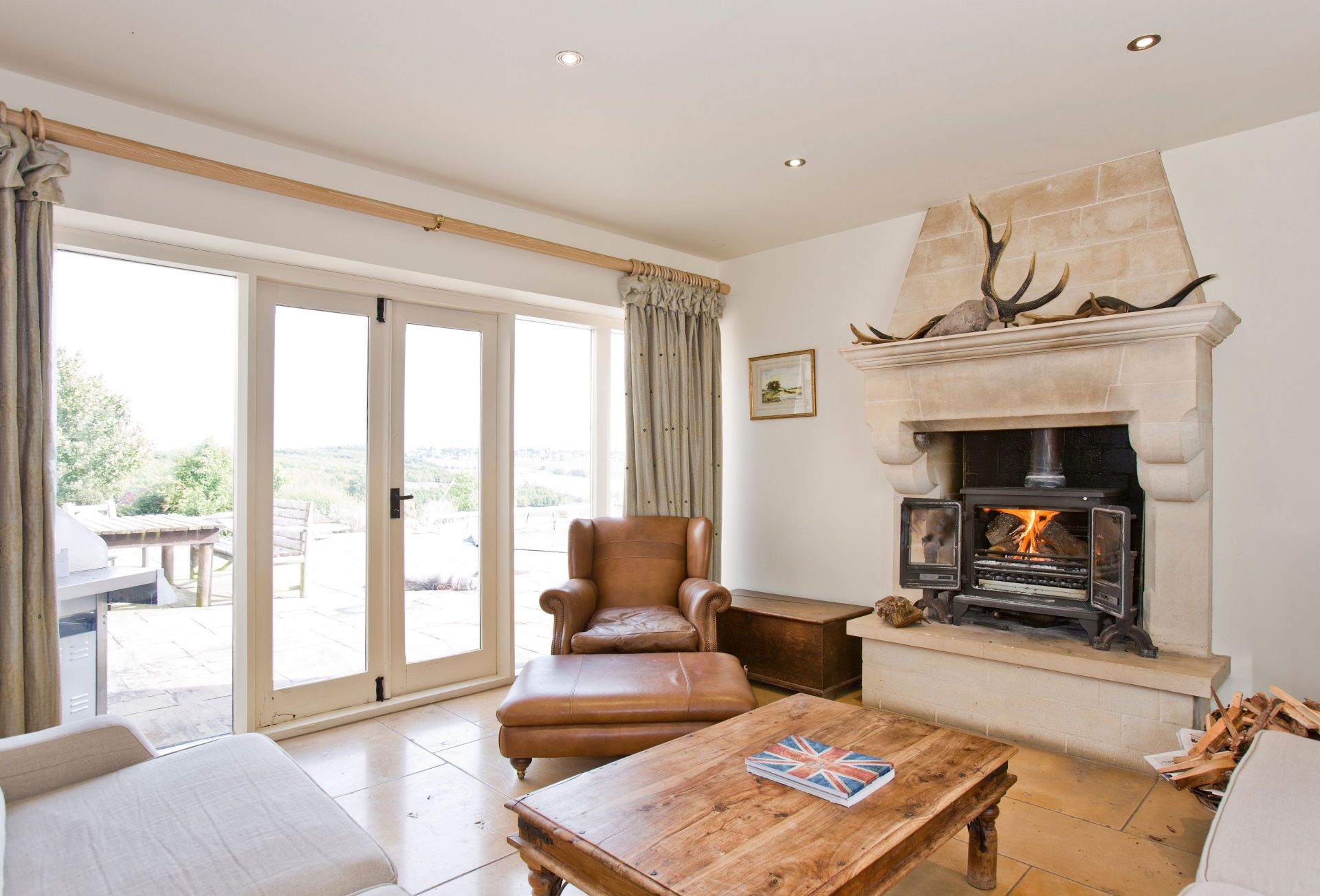 Ground floor:  Sitting area off the kitchen with magnificent wood burning stove and doors to the garden