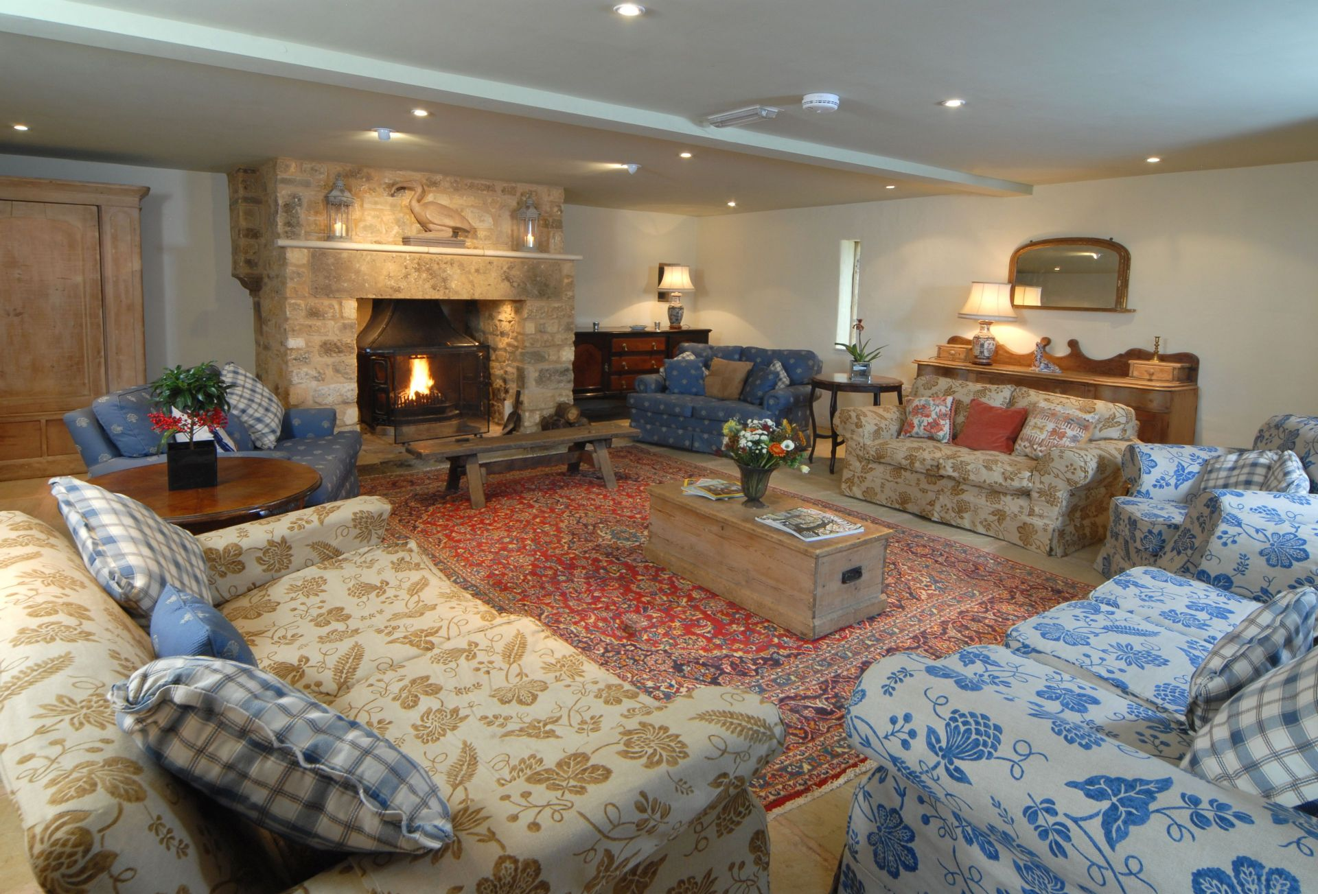 Ground floor:  Sitting room with comfortable seating for 12 people in front of an open fire