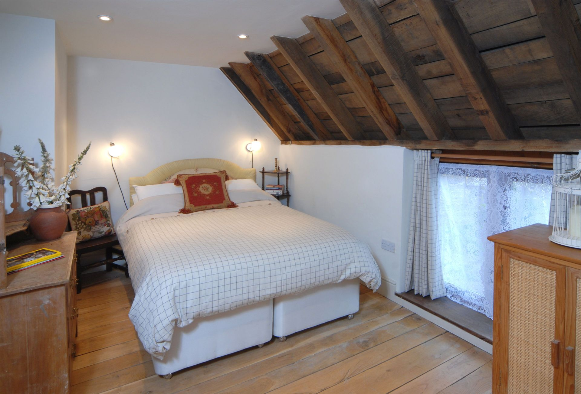 First floor: Bedroom three with double bed