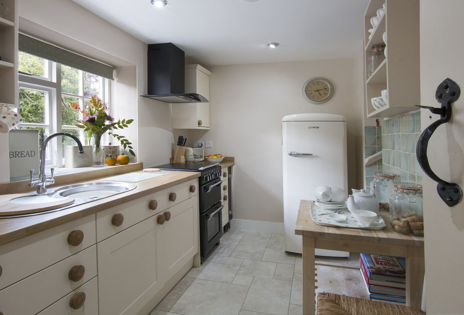 Ground floor:  Kitchen with two steps up to sitting room