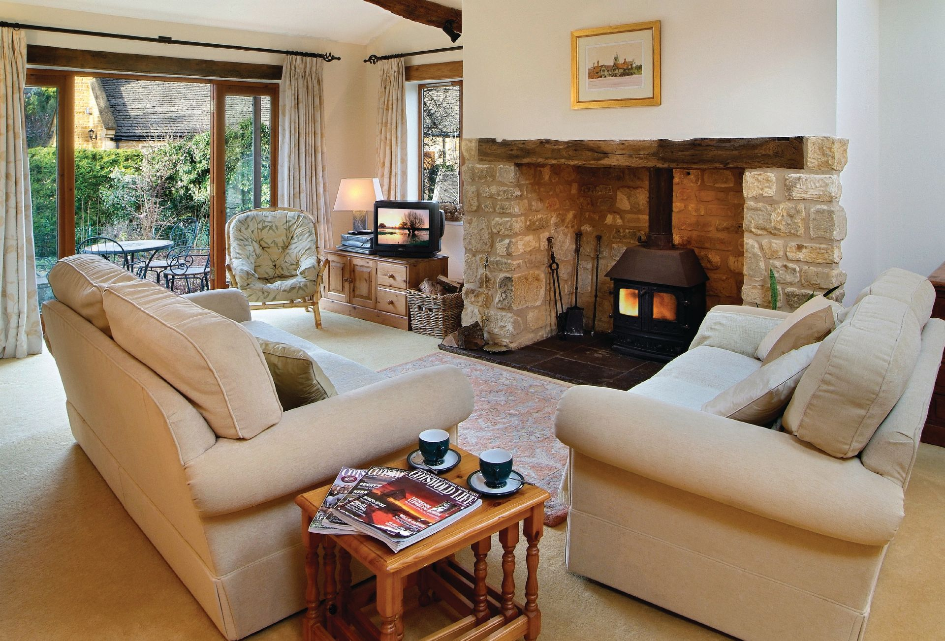 Ground floor: Sitting room with wood burning stove and french doors to garden