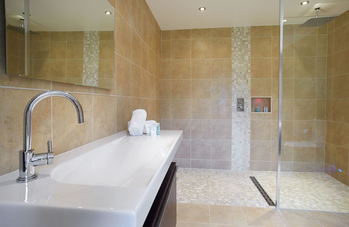 Ground floor: En suite bathroom with separate shower